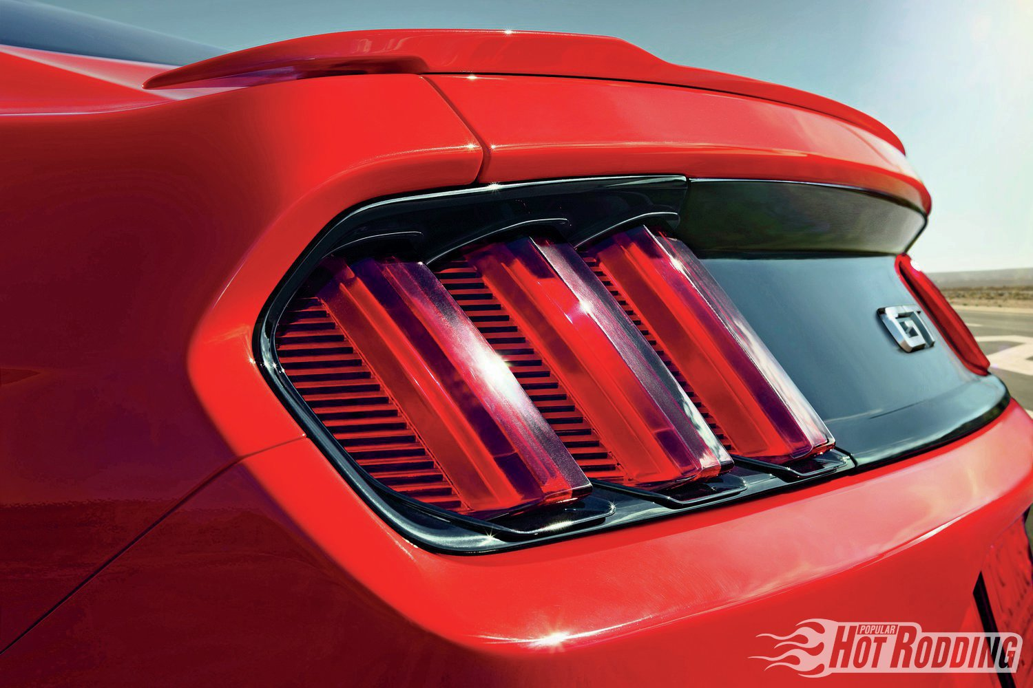 "Another deliberate nod to Mustang tradition is the Tri-bar taillamp. ""I'm just a sucker for history,"" says J Mays, Ford design chief. The Mustang was the final bow for the famed stylist, who retired weeks after the debut."