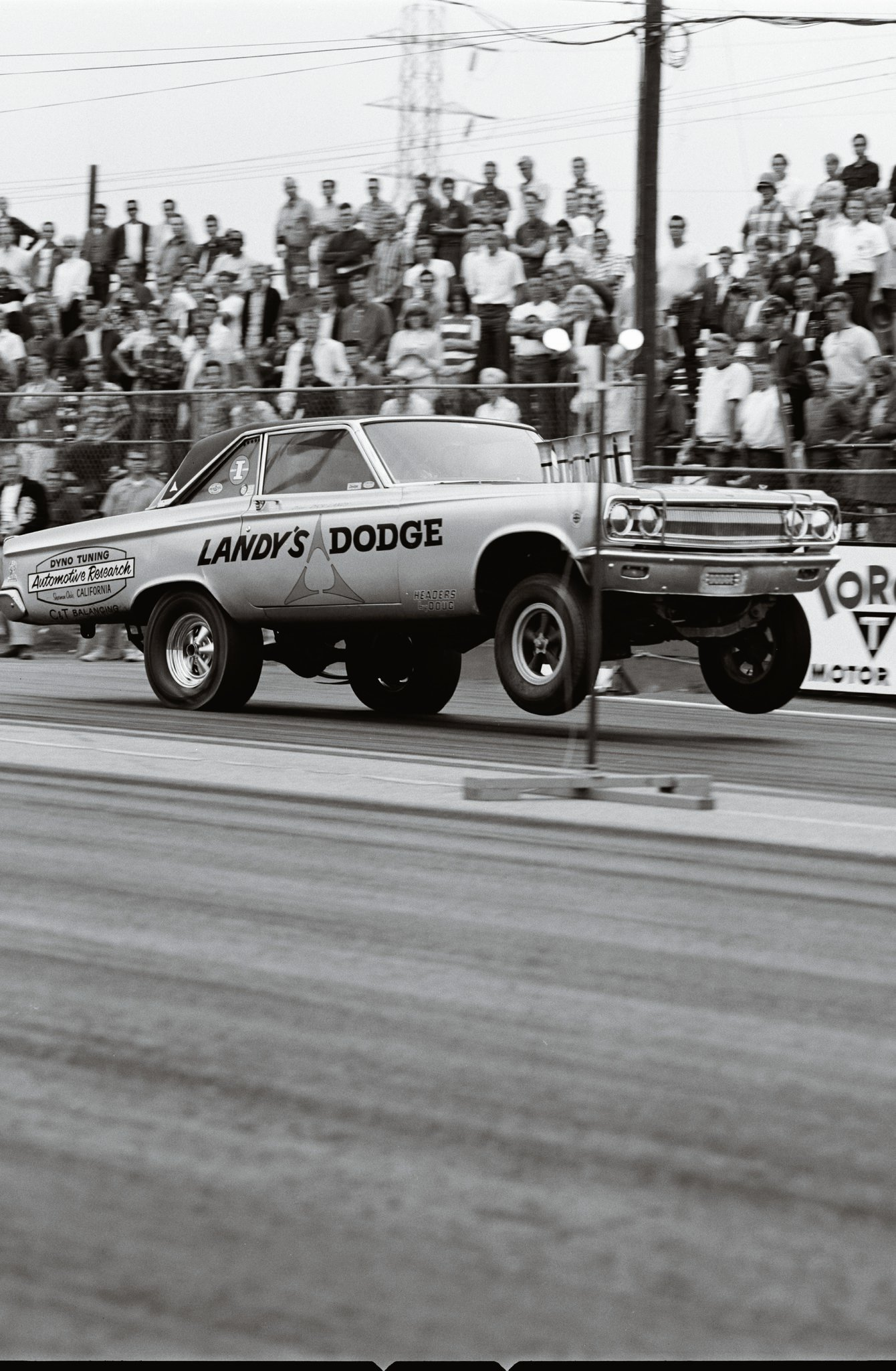 The Ramchargers were first to show up with one of those funny-looking altered-wheelbase (AWB) cars. The radical modifications resulted in better weight transfer and increased traction at launch. Dick Landy realized the benefits and built this '65 injected Hemi AWB Dodge Coronet. These funny-looking AWB cars soon evolved into the Funny Cars that still run today.