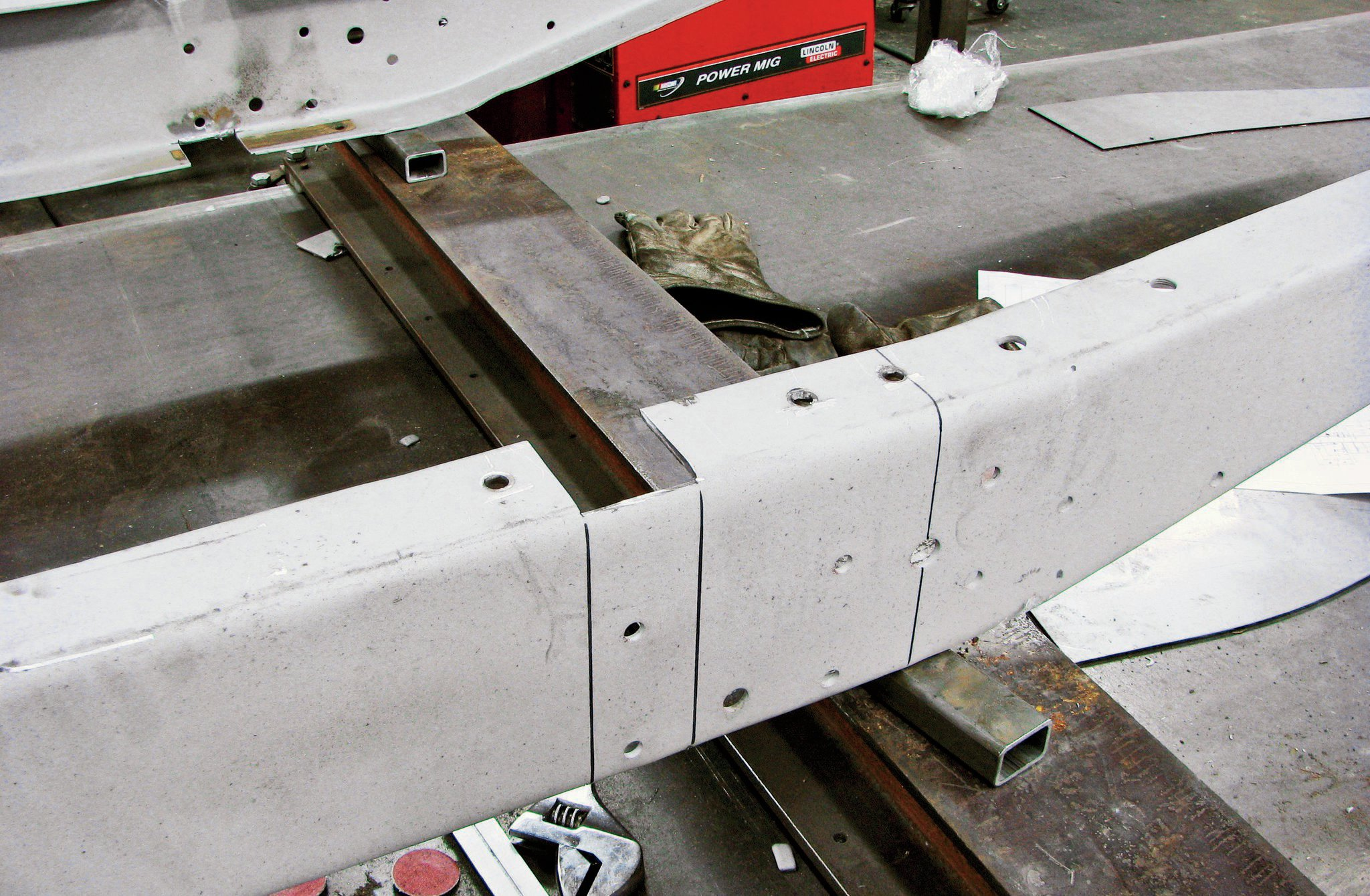 4. Notches are cut in the frame's top flanges that allow the new crossmember to be dropped in place.