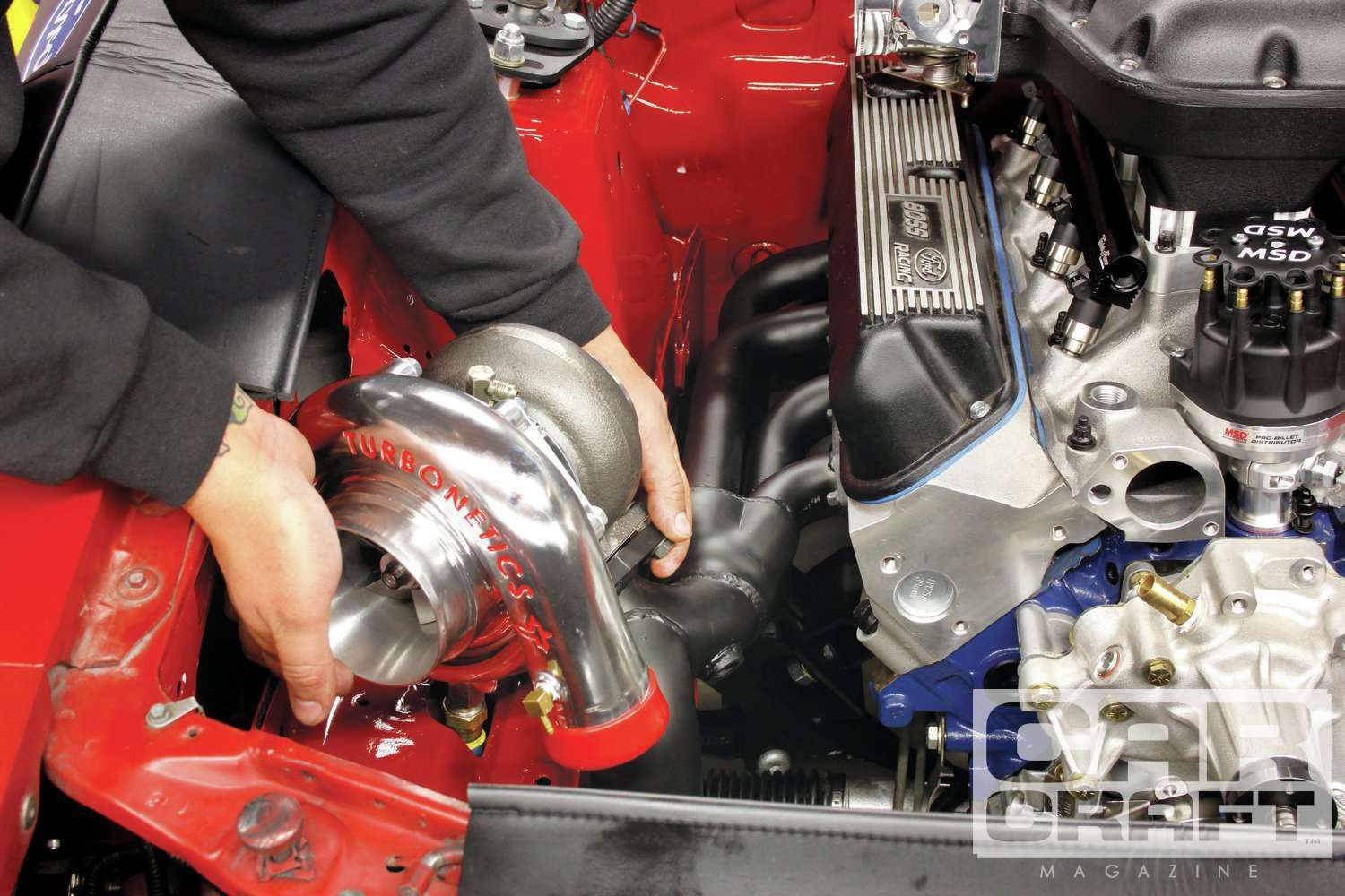 The larger turbo crashed into the inner fender because of its larger housing. The increased height of the exhaust port on the Z363 also moved the downpipe and crossover positions, requiring some fabrication.