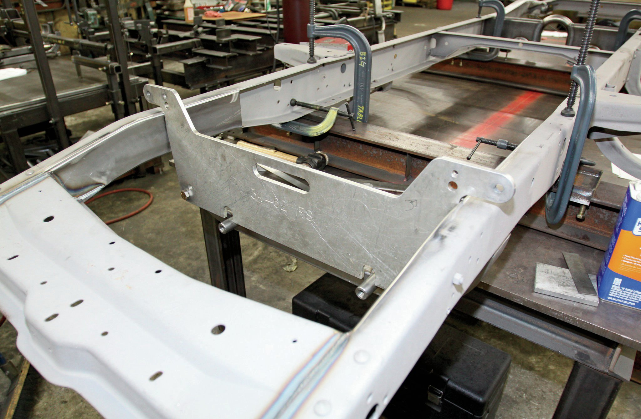 11. With the crossmember welded in place, this fixture is used to locate the upper A-arm mounting points.