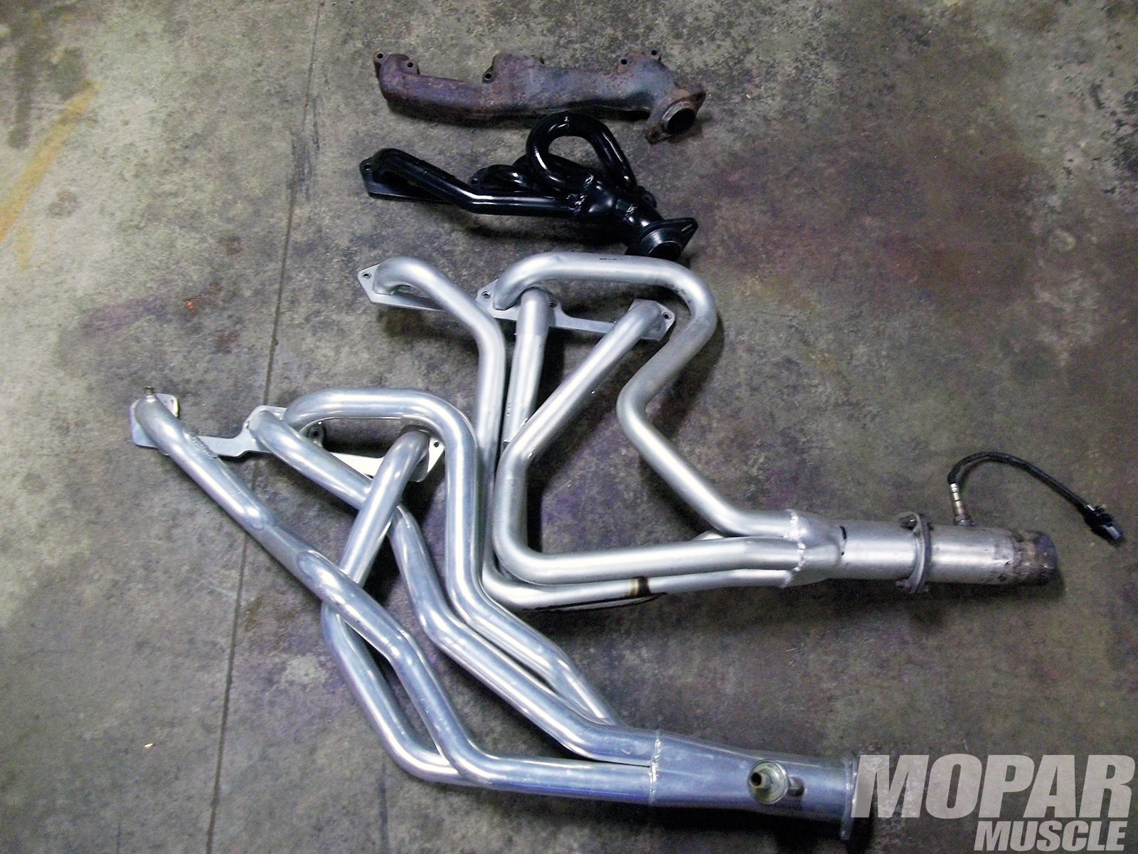 2. From top to bottom, 360 Magnum manifolds, PaceSetter shorty Magnum headers with 11⁄2-inch primaries, Hooker small-tube headers with 15⁄8-inch primaries, and Hooker large-tube race headers with 13⁄4-inch primaries.