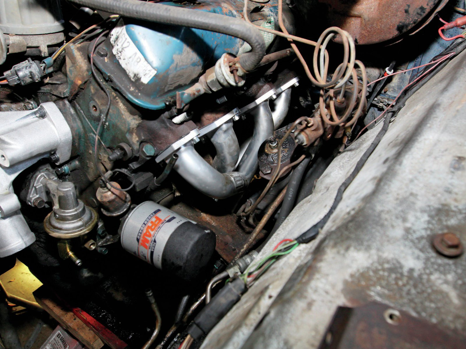 17. Before installing the first bolt I positioned the header gasket into place. Start the bolt with your left hand, and hold the gasket into place with your right. Tighten the bolts down evenly as you would torque a head gasket.