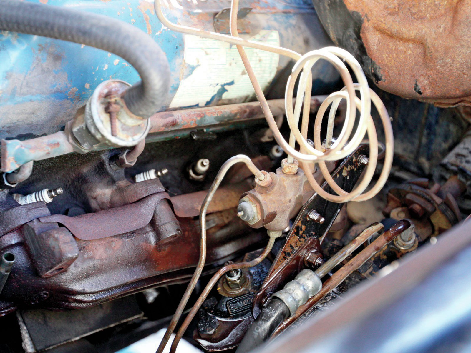 10. See the wet bolts? For any disassembly work it's a good idea to presoak with penetrating oil. I didn't break the lines, the proportioning valve pushed to one side for clearance.