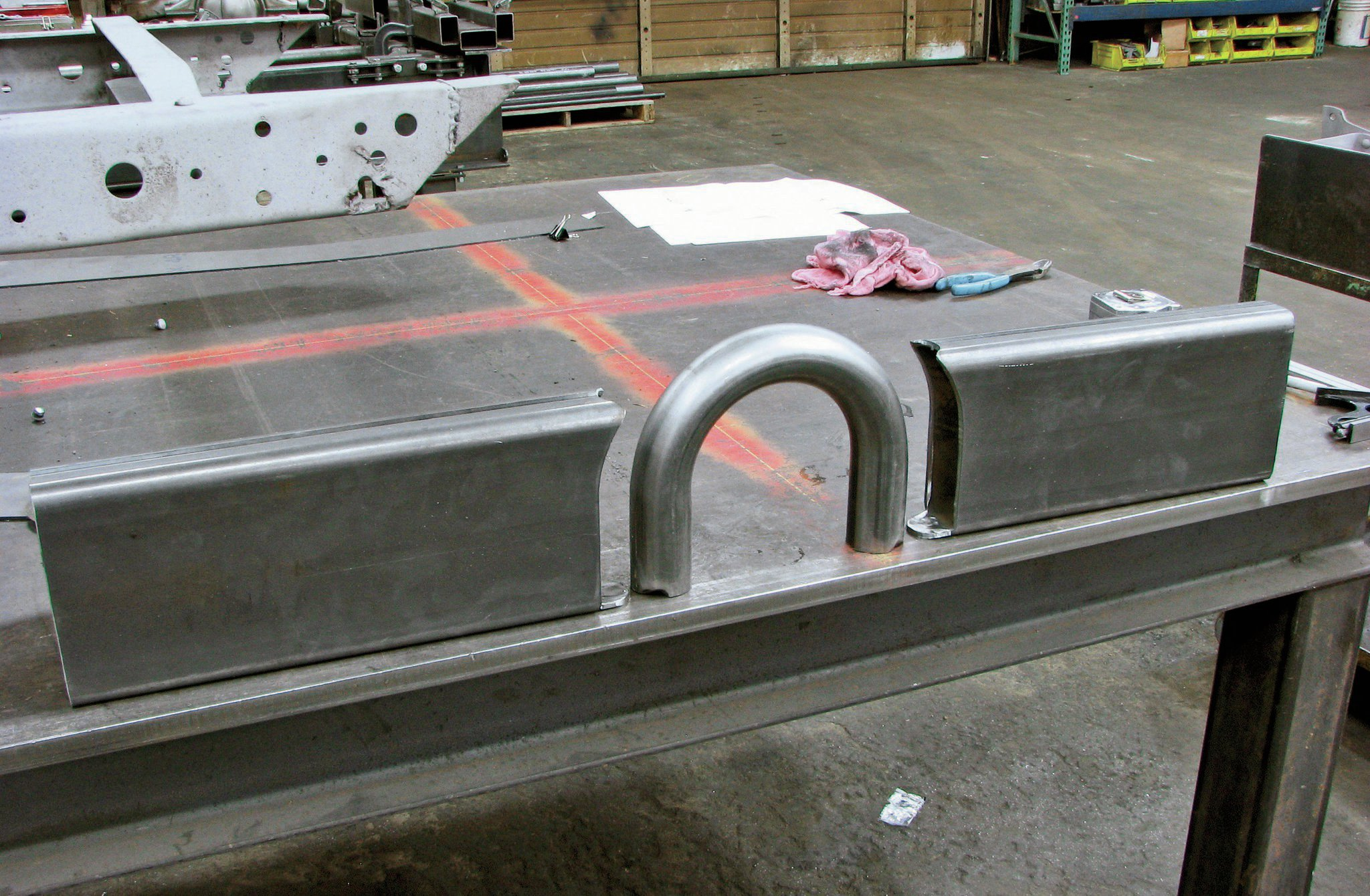 3. These are the components of the rear crossmember that will mount the four-bars. The hoop is for driveshaft clearance.