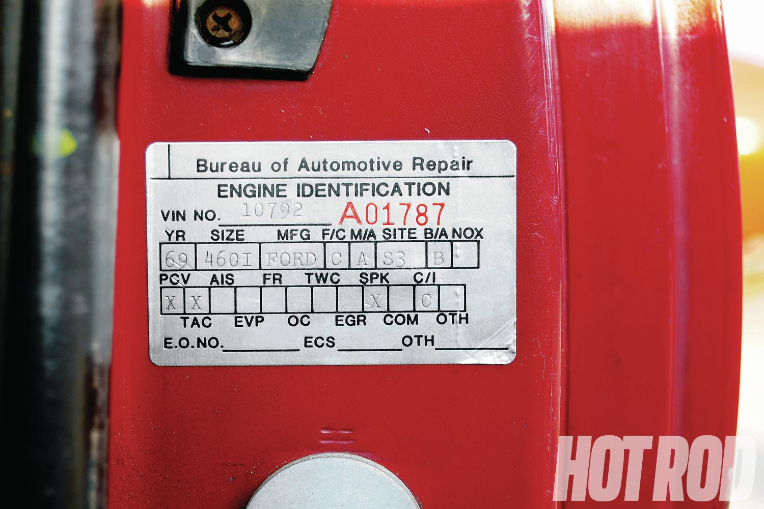 """This is a typical California referee engine swap sticker. The rare """"B"""" in the B/A box means the '69 Lincoln 460 V8 was legally swapped into this '83 Mustang """"Before"""" March '84. Prior to that date, California's swap regs were based on the engine year instead of the car's model year. As noted on the sticker, only a PCV valve, TAC (thermostatic air cleaner), spark-controlled distributor, and stock carb were needed. Lucky stiff!"""