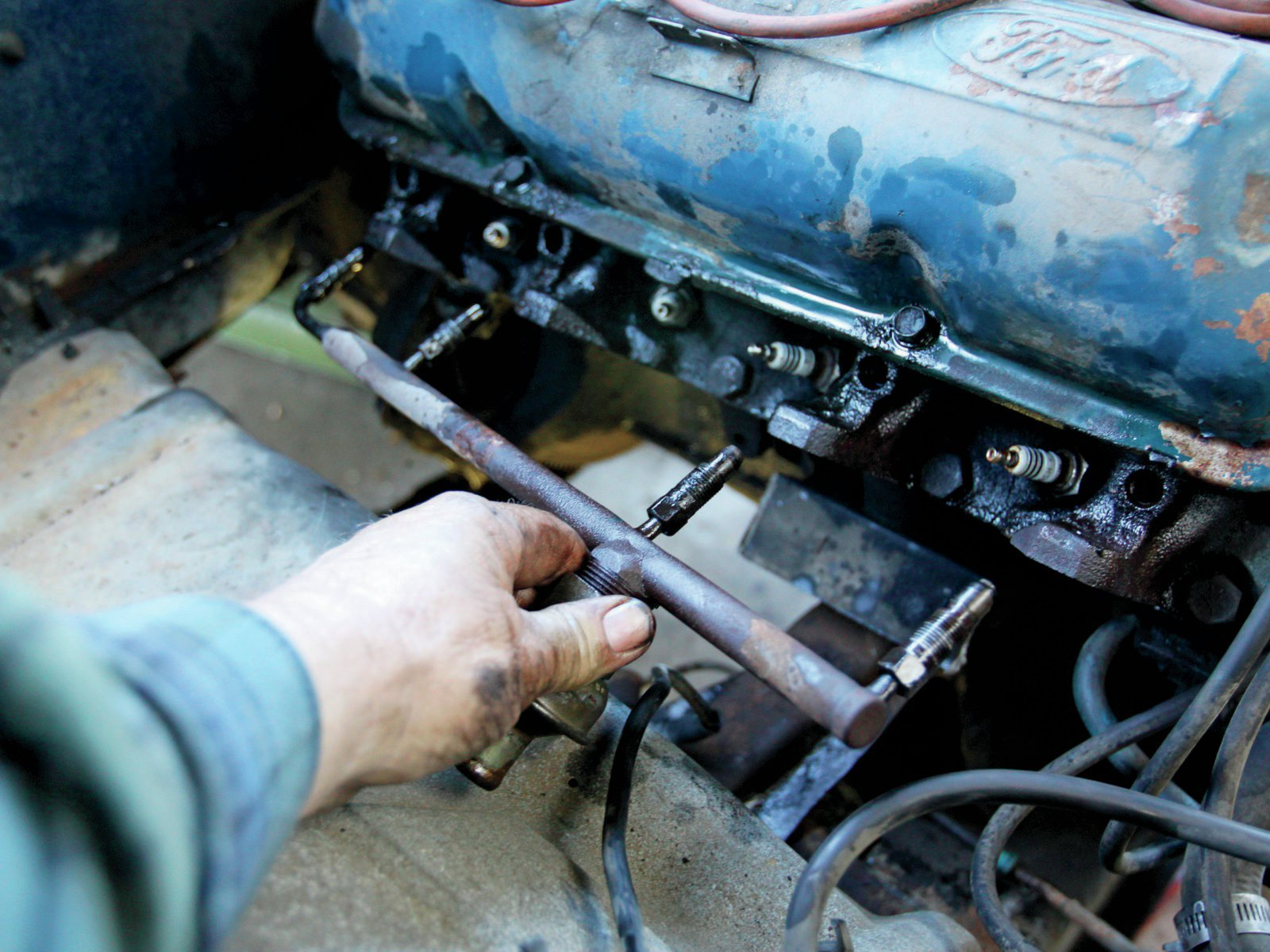 19. Removing a smog rail can be real mean. Presoak with penetrating oil, and use a flare-nut wrench to avoid rounding the flats.