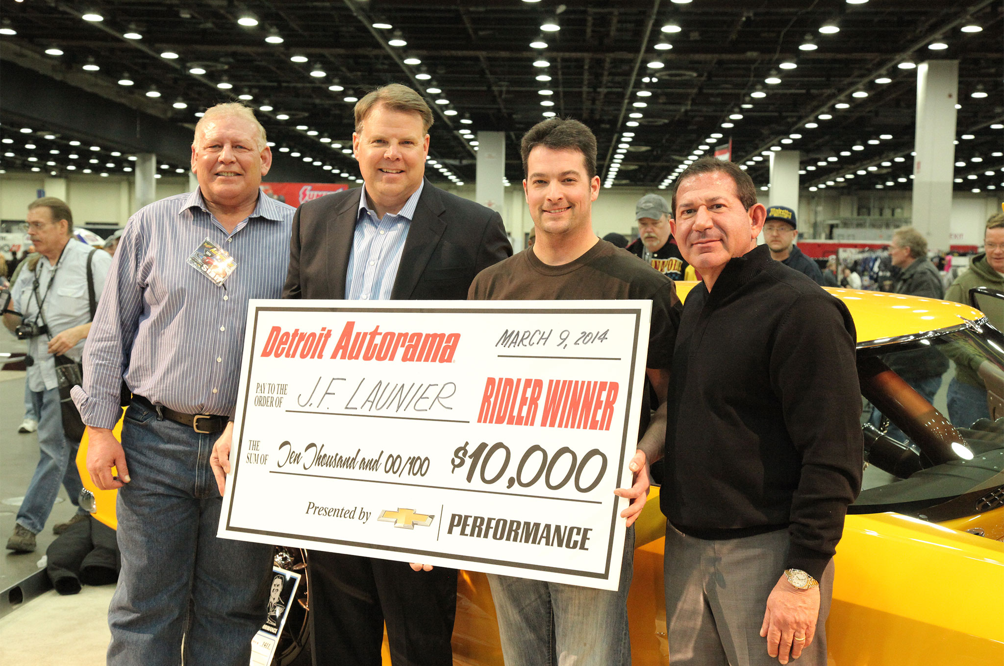 Launier, second from right, is presented with a $10,000 check by (from the left) Michigan Hot Rod Association's president, Butch Patrico, the U.S. Vice President of Performance Vehicles and Motorsports for General Motors Corporation, Jim Campbell, and Championship Auto Shows' president, Pete Toundas.