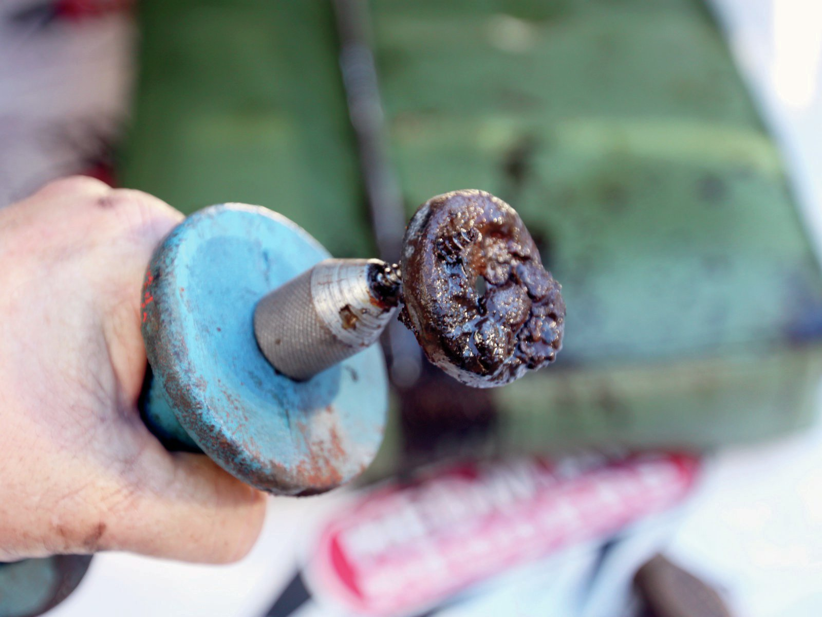 12. A slide-hammer works great to remove bad freeze plugs. Scrape and sand clean the heavy rust formations left behind.