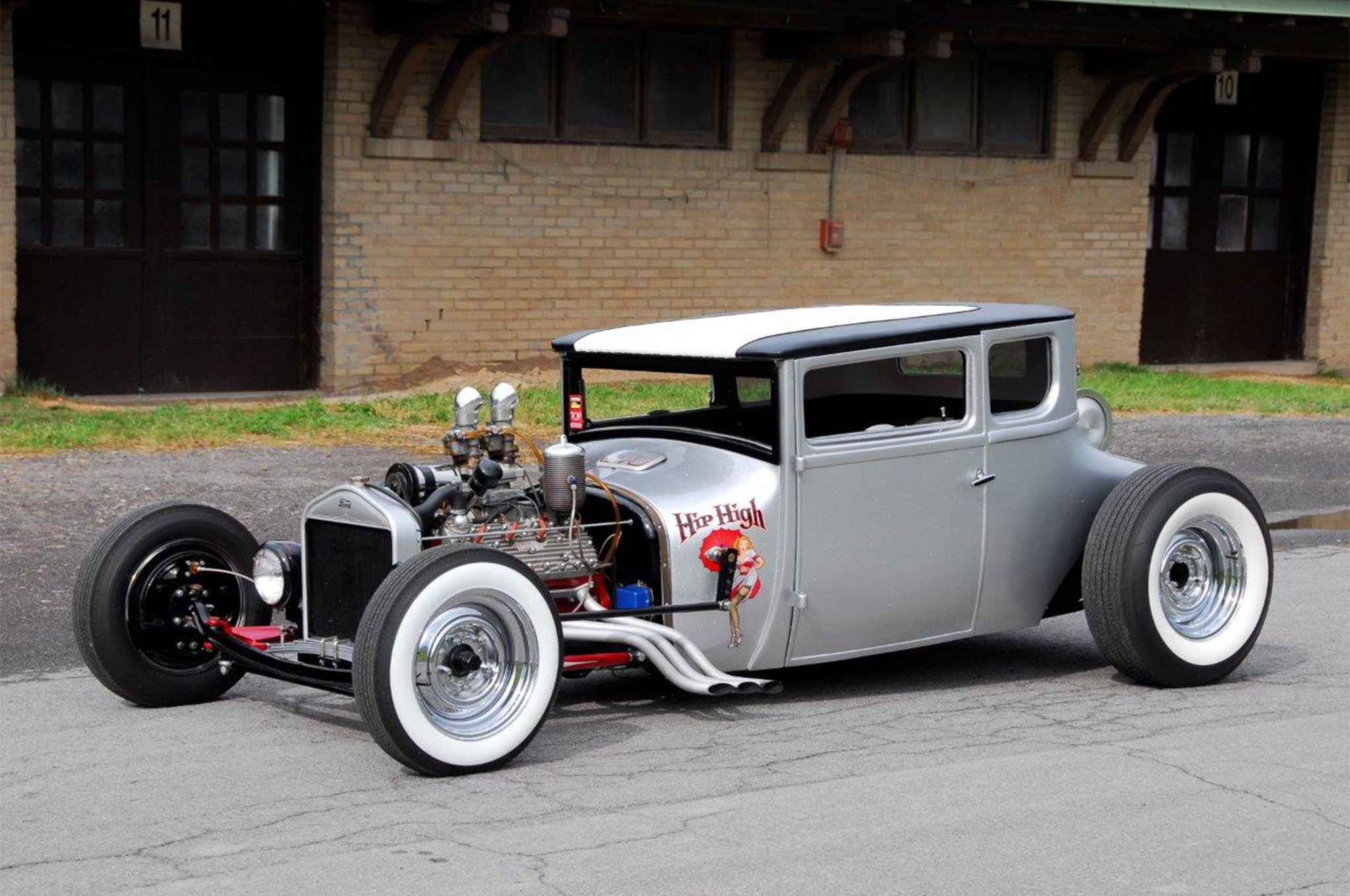 Looking like a Rattler ready to strike, Mike 's coupe gets its attitude from a healthy 9-inch chop and glitz from gallons of PPG silver metalflake. Cowl steering, a 4-inch Z and 14-inch rear kick add the final bit of voodoo to the cauldron.