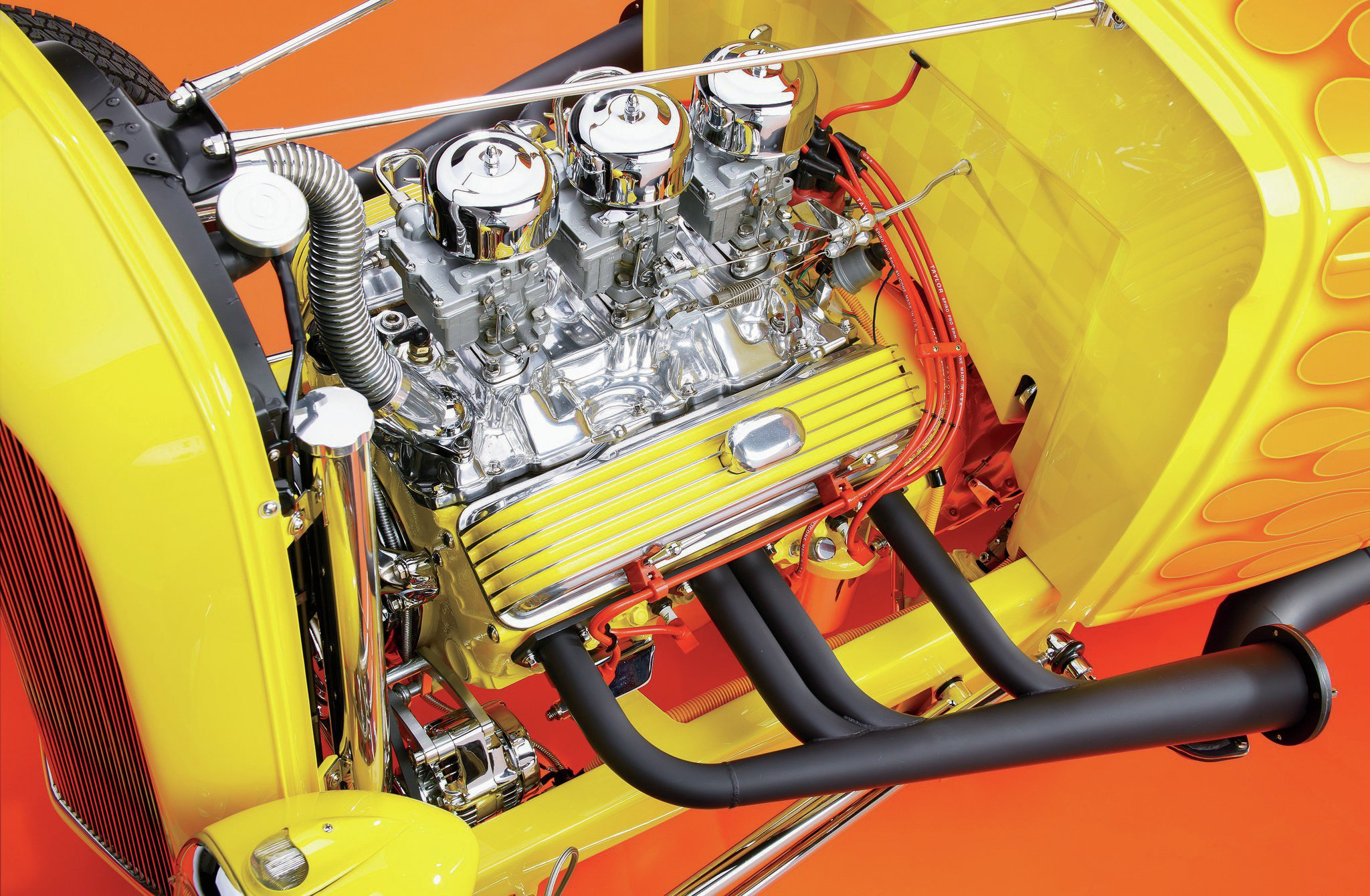 The highly detailed 383 small-block Chevy features a great deal of chrome and polished aluminum. The ignition is Mallory with Taylor wires. The Tri-power is based on a vintage three-bolt aluminum intake with four-bolt adaptors that allow the use of a setting of three Rochester 2G carbs topped with '32 carb air cleaners filled with K&N elements.