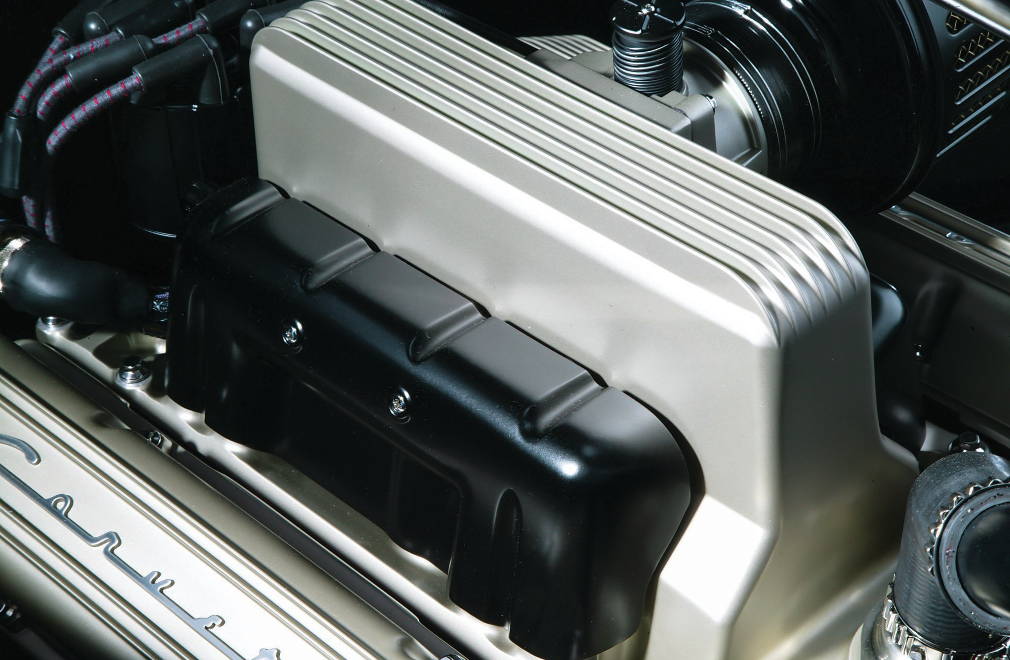 The 383-inch stroker SBC was built by Ben Adams of Adams Automotive that utilizes an MSD ignition, a Billet Specialties Tru Trac serpentine belt system, and a billet Powermaster alternator. The mechanical fuel injection made famous on Corvettes and other GM cars was the old Rochester unit. This may look like a first-generation FI but in fact it's a modern Ram Jet EFI made to look old.