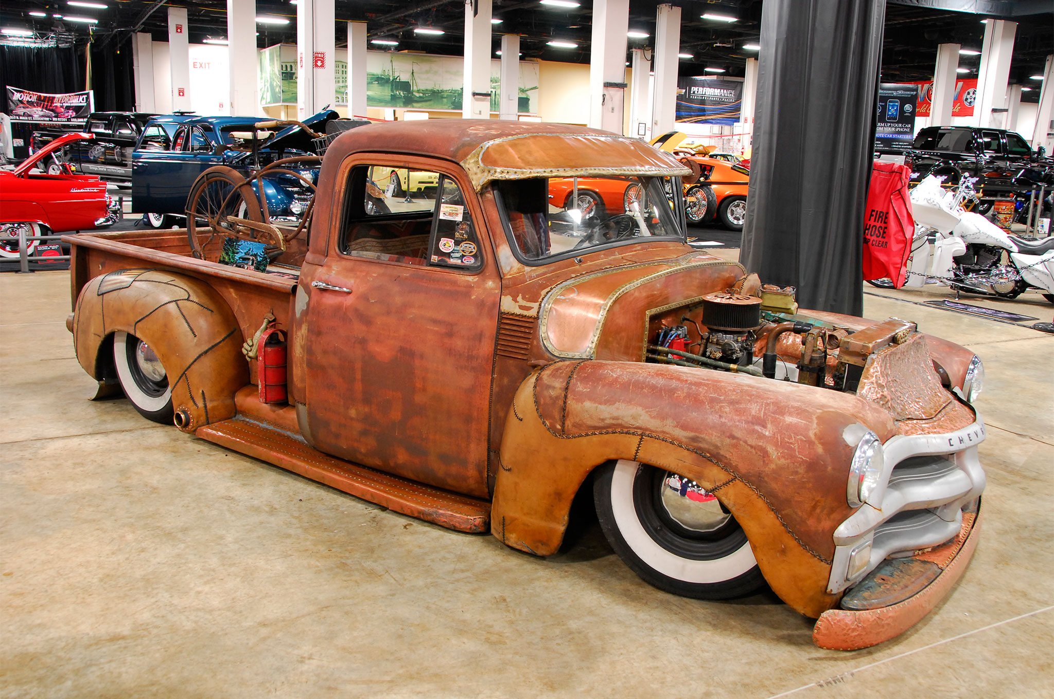 Craig Dolan's 1954 Chevy hauler was a real crowd-pleaser with its ground-scraping stance, body accented in leather and copper, vintage bike in the bed, and Chevy small-block power.