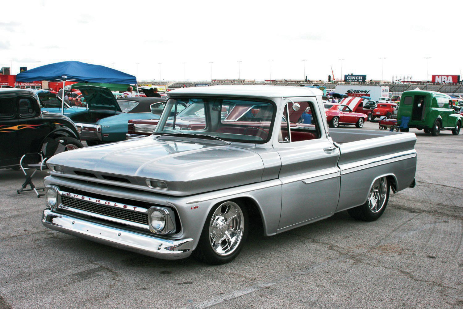 Another of my favorite pickups at the show was Greg Hampton's 1965 Chevy C10. This classy cruiser is powered by an LS1 backed by a 4L60E overdrive automatic. Its white-over-silver two-tone paint, Billet Specialties wheels, and perfect stance are on the money.