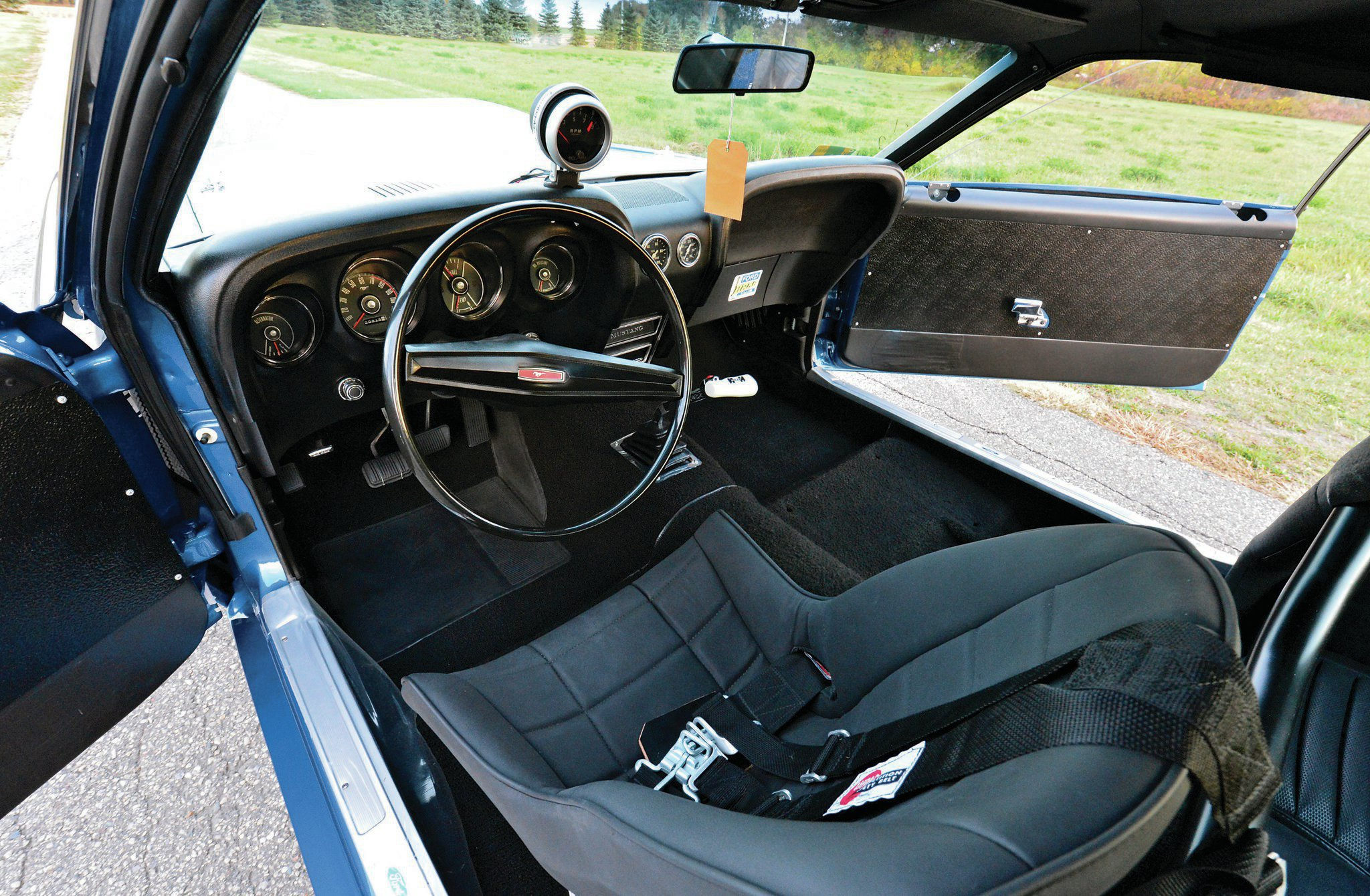 The interior came with Hubert Platt's favorite seat from his previous race Mustang. The Stewart-Warner water temperature and oil pressure gauges were installed by Holman & Moody-Stroppe, as was the original Auto Meter tachometer, which reads to 9,000 rpm with a variable pointer for redline.