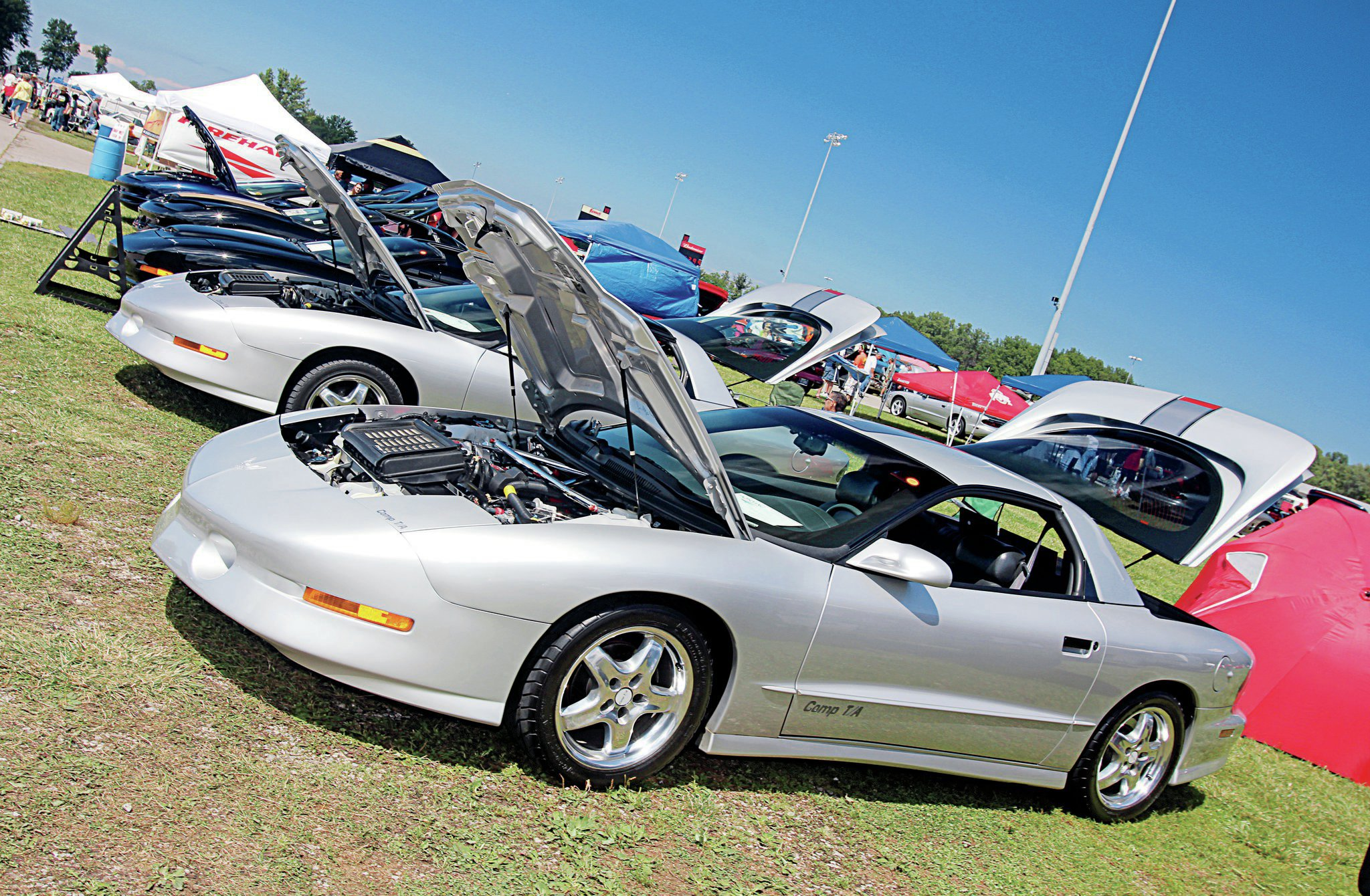 The Firehawk Association of America hosts its own annual show as part of the Ames Performance Tri-Power Pontiac Nationals. This is the largest gathering of Comp T/As and Firehawks anywhere since they left SLP. Kevin and Sarah Day brought their '95 Comp T/A from Jackson, Michigan, to participate.