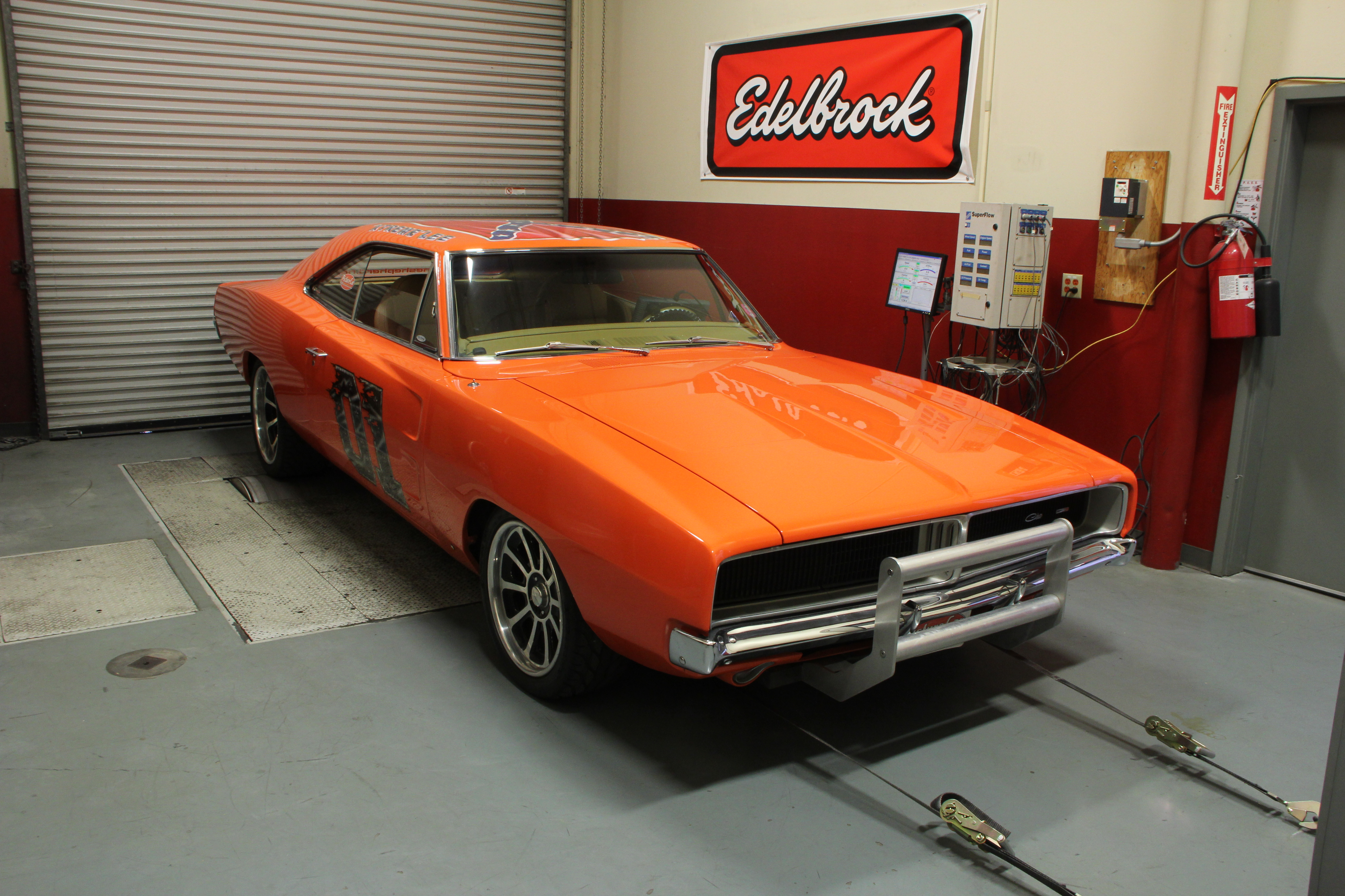 This is Kenny's '69 Charger. Orange, big-block, push bar and General Lee inspired graphics. What's not to like?