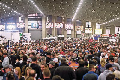 The Chili Bowl pit area in the Tulsa Expo Center in Tulsa, Oklahoma is jammed packed with fans from all over.