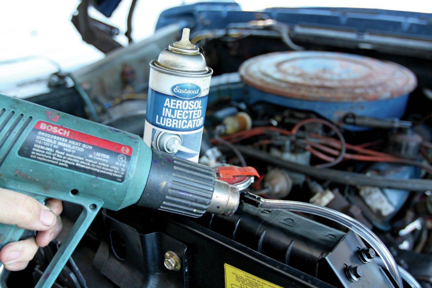 18. Antifreeze is poisonous. The coolant overflow line should always be connected to an overflow bottle. A heat gun or a good lubricant eases hose installation.