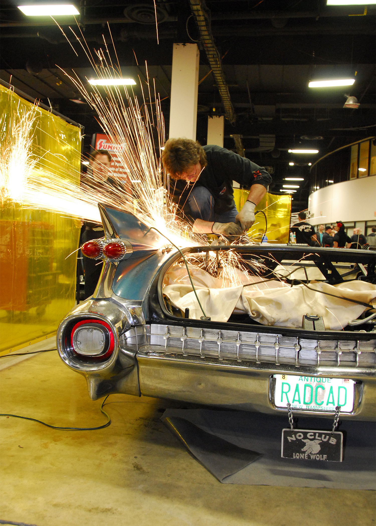 Sparks flew as the team worked to prepare the body for the lowered lid. Here you can see Winfield behind the scene monitoring the progress.