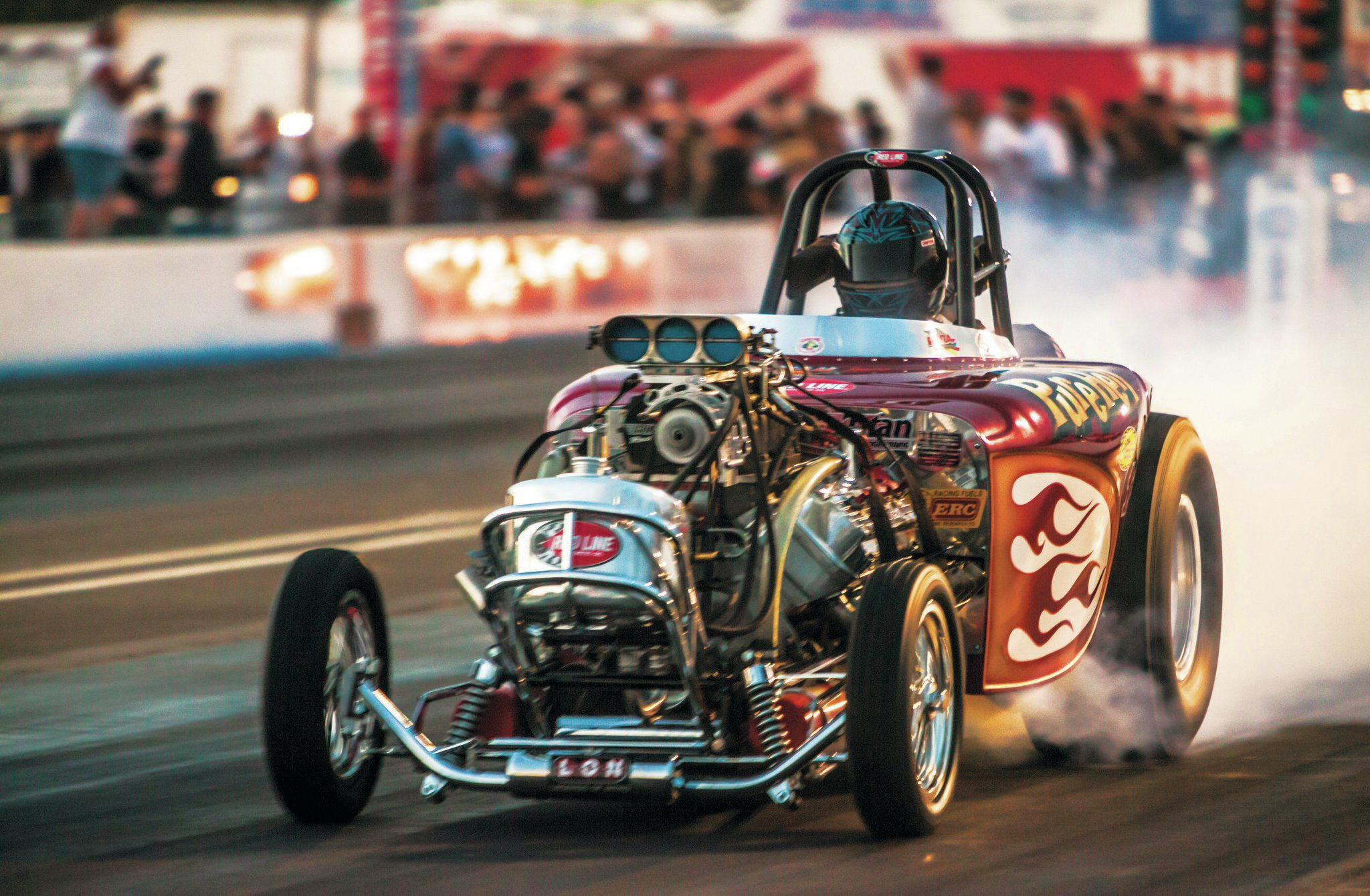 Ron August, Jr. pulled double duty at the March Meet, not only manhandling Rich Guasco's Awful Awful, but also went rounds in the Forever Young front-engine Top Fuel dragster.