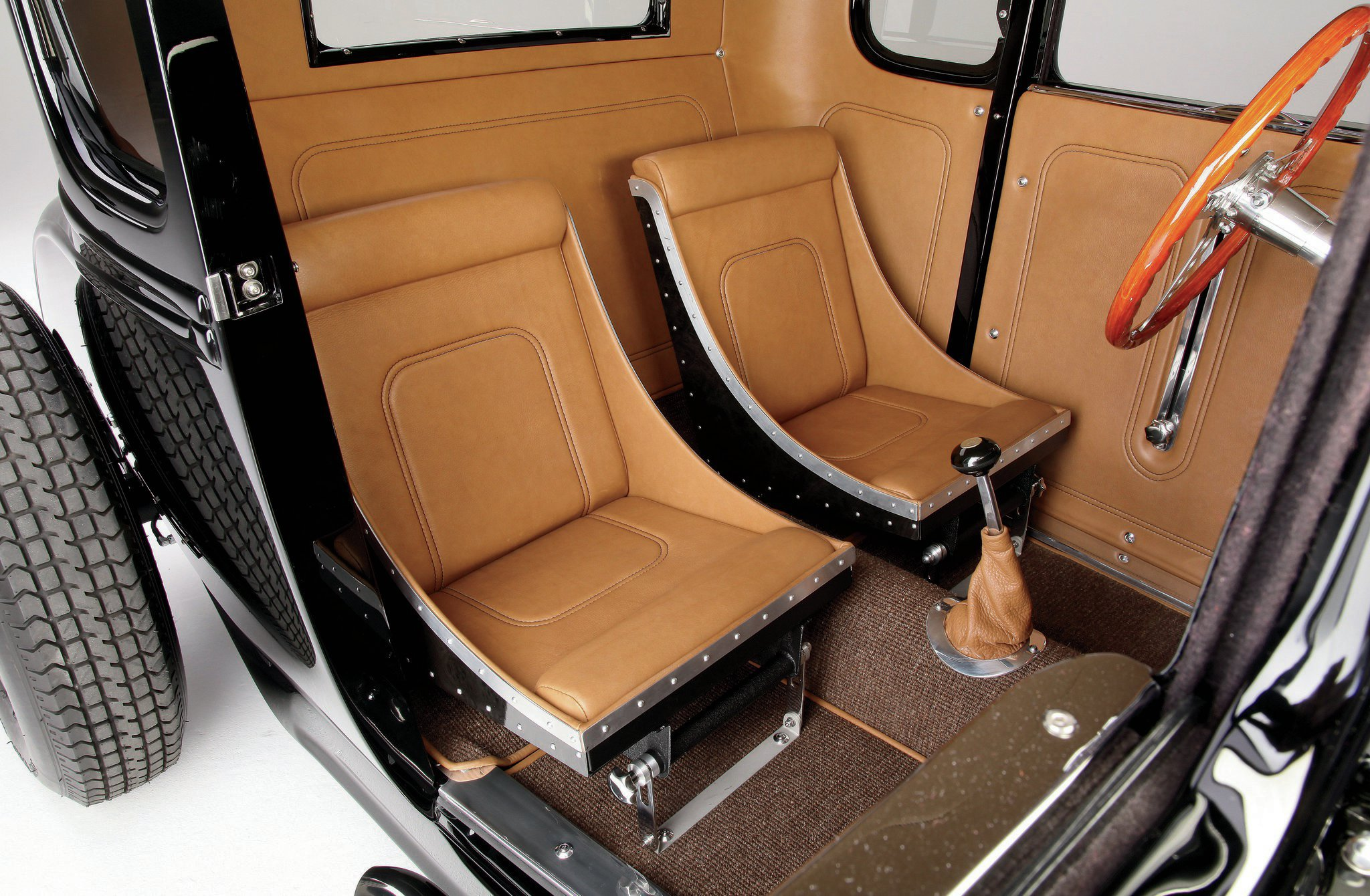 McCarter used leather to cover them, and used the material on the door panels and the rest of the interior, too.