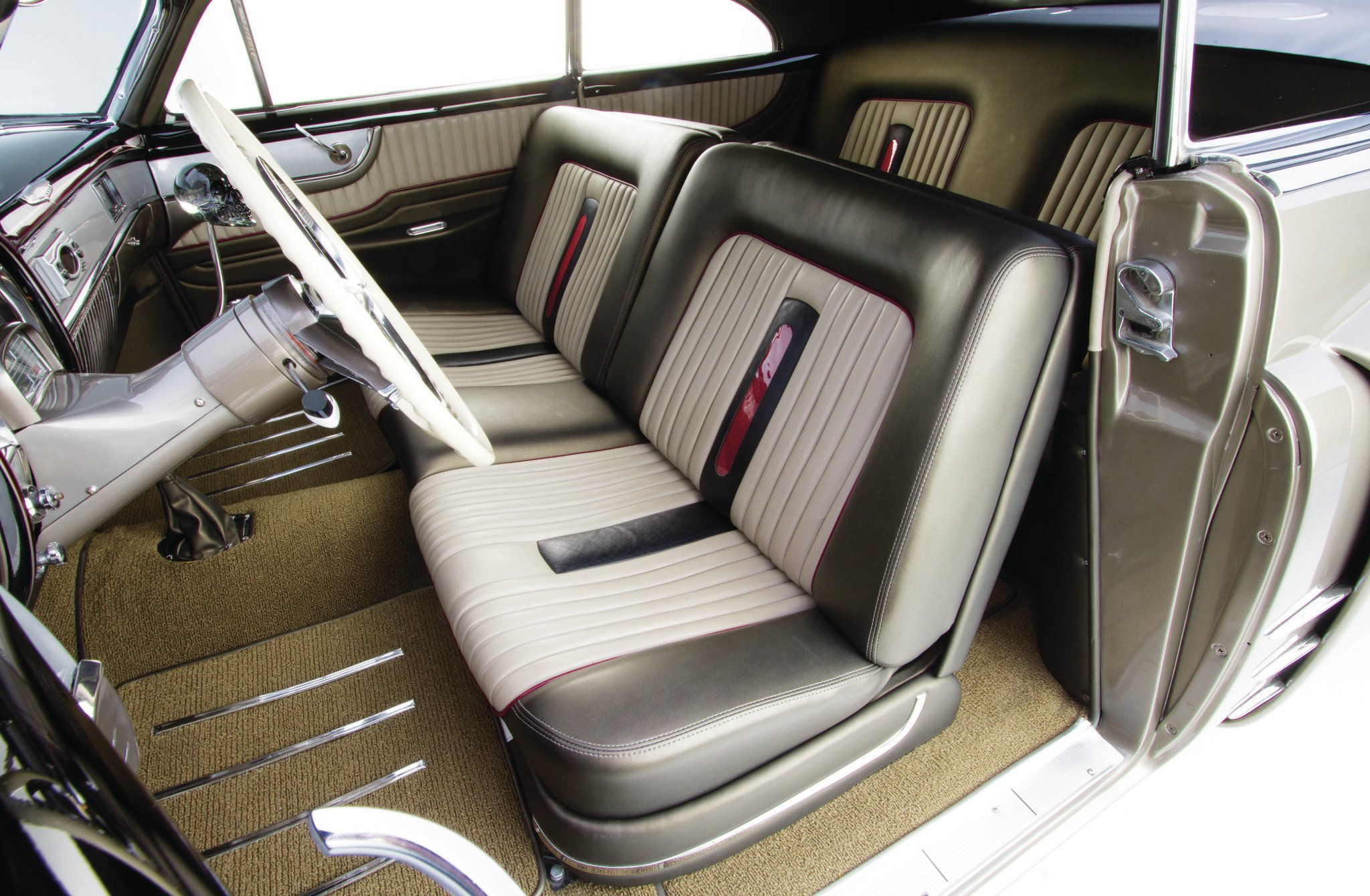 Mike's Cad carries the body colors and accents into the upholstery, done by Elegance Auto Interiors in Upland, California. The sculptured door panels tie in well with the brushed panels that carry the dash into the doors, a nice touch found on all '51 Cads.
