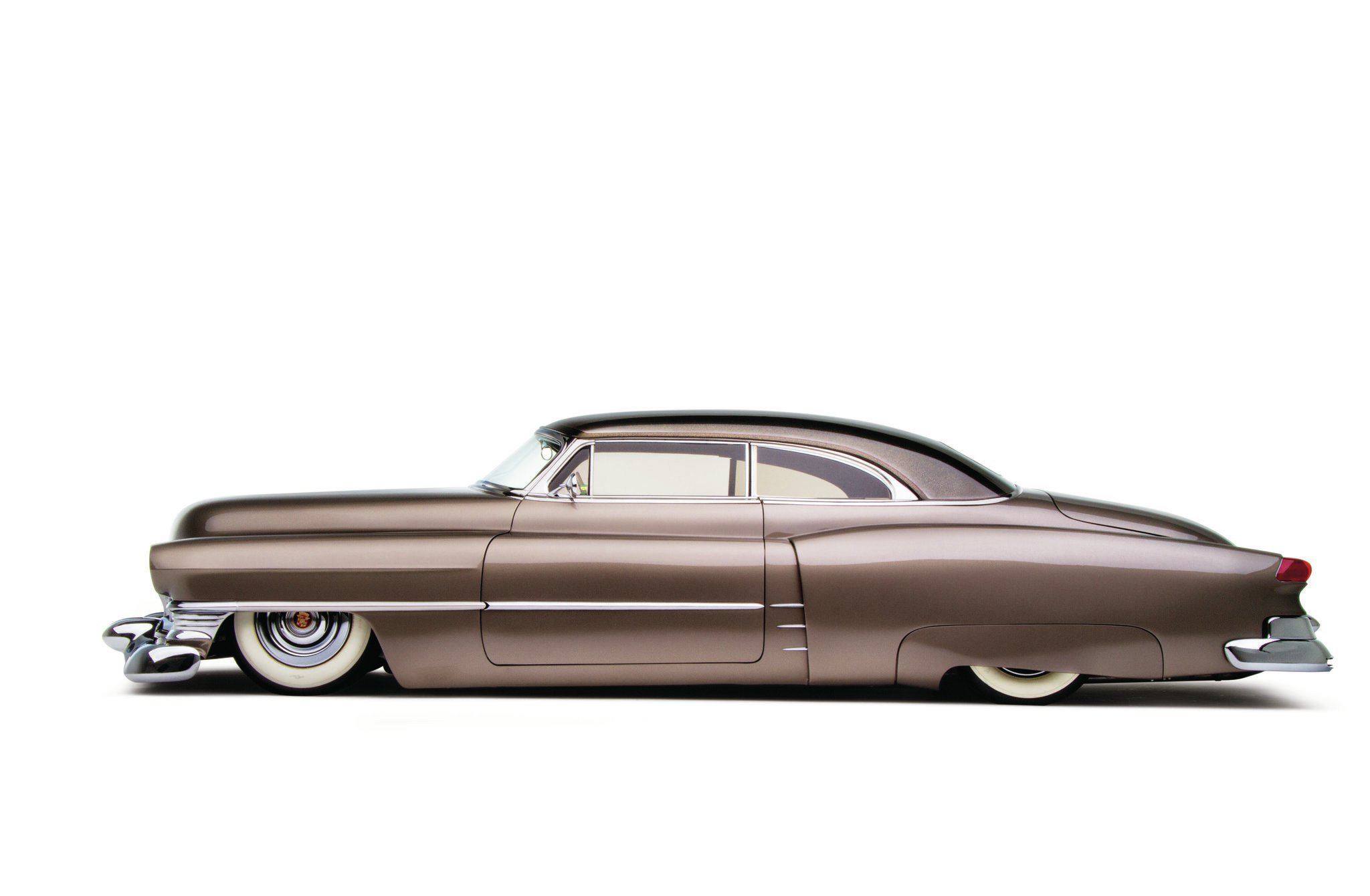 """In profile, you can see the subtle chopped top, extra chrome accents coming out of the stepped rear fenders, and how the '54 Clipper """"sore thumb"""" taillights blend well with the fenders. The skirts are also modified to reveal more of the gangster tires."""