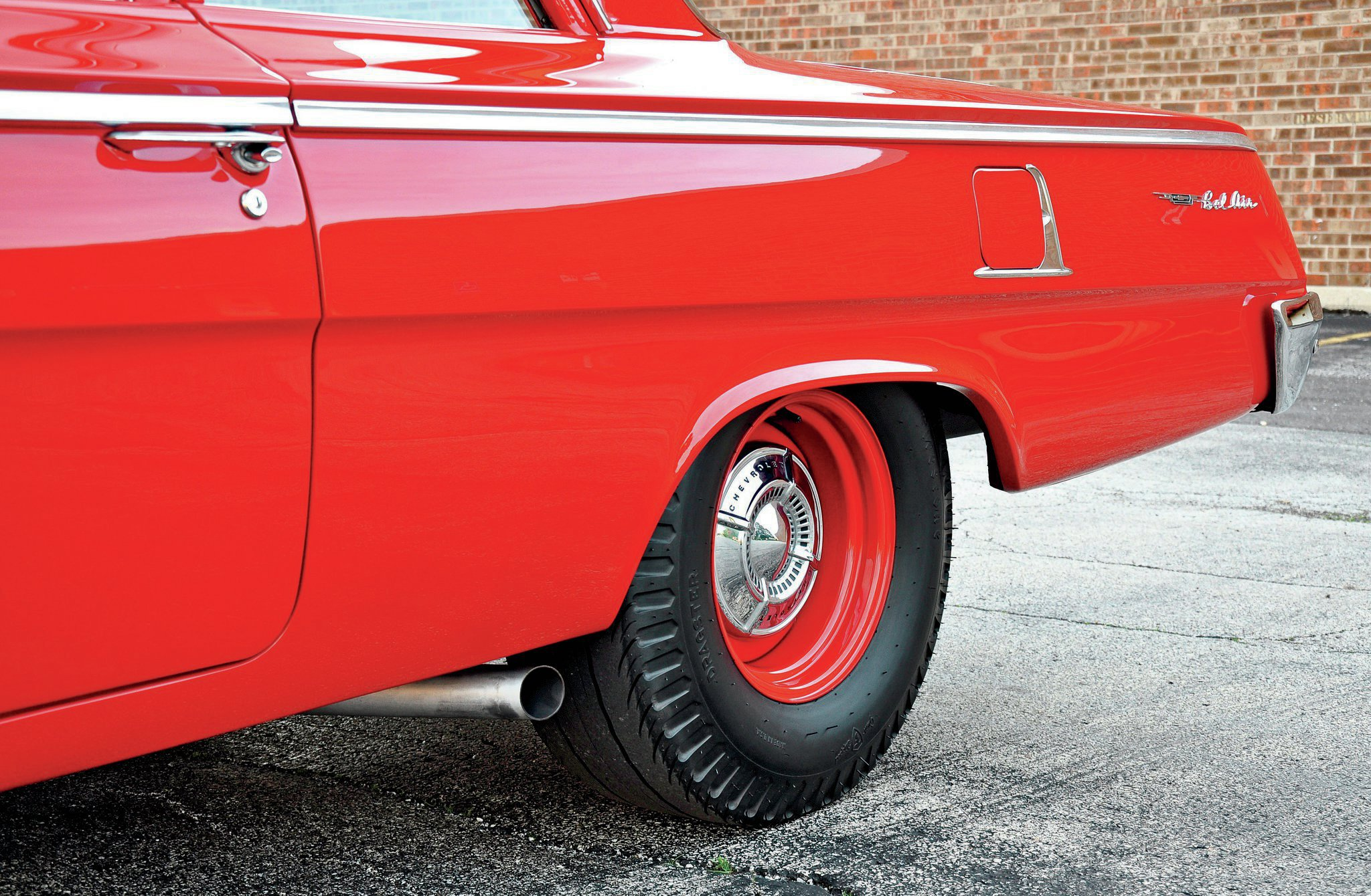 The Positraction axle cost $43.05. Bill's car comes with the 4.11 gears. Coker Tires Firestone cheater slicks are period perfect, especially mounted on proper 15x8 steel rims from Wheel Vintiques. The gas door trim was a Chevrolet accessory item.