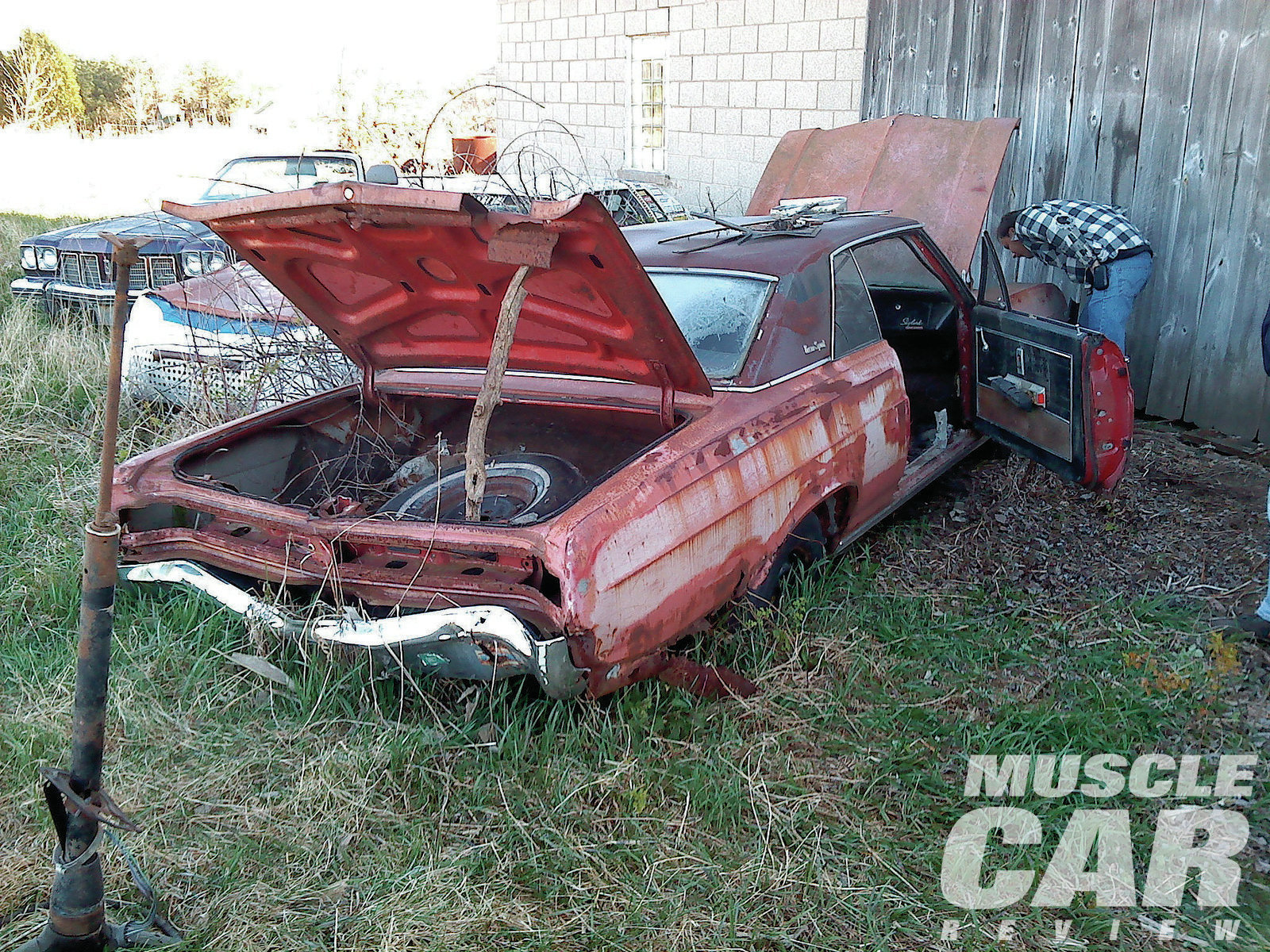 The Buick GS was out of sight behind this barn north of Green Bay, Wisconsin. The fact that people are tracking down cars so far gone reveals the rarity and desirability of this muscle car.