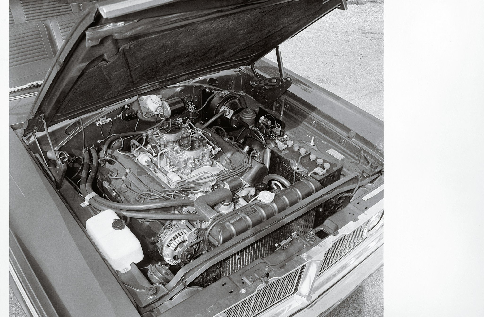 "The Street Hemi was a detuned version of the racing engine, with cast iron heads and intake manifold and a compression ratio that dropped from the race version's 12.5:1 to 10.25:1. ""Dual Carter AFBs operate progressively, rear opening first, then front,"" wrote Dahlquist about the induction system."