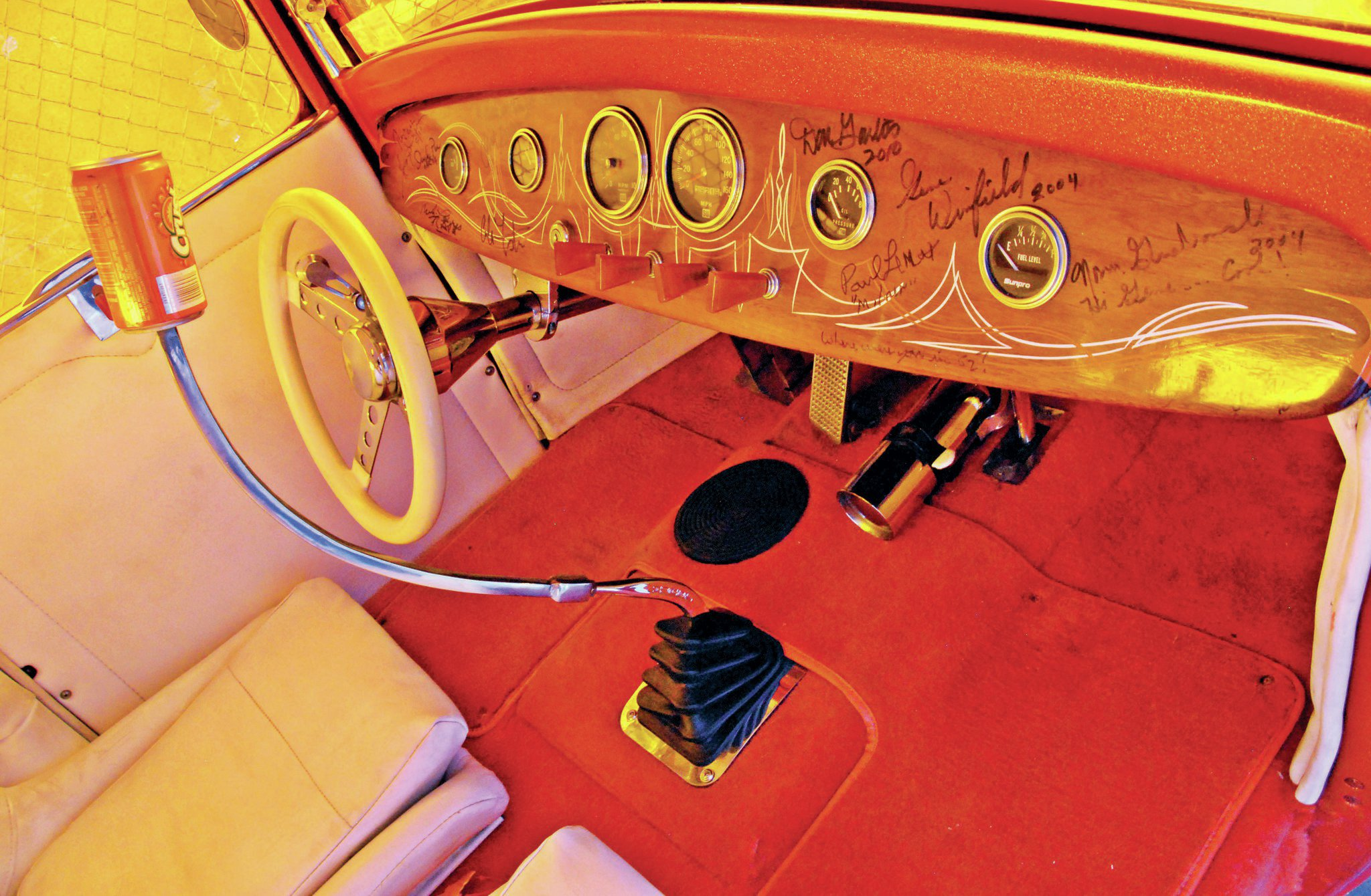 Wild shift lever (with an Orange Crush can on top, what else?) controls a Muncie four-speed out of a '66 Chevelle. Joining the trans to the Hemi is a rare Moon Chevy-to-Hemi adapter. It may be tough to see in the photo, but Vinny has some big-time autographs on his dashboard—Don Garlits, Gene Winfield, and Norm Grabowski, to name a few.