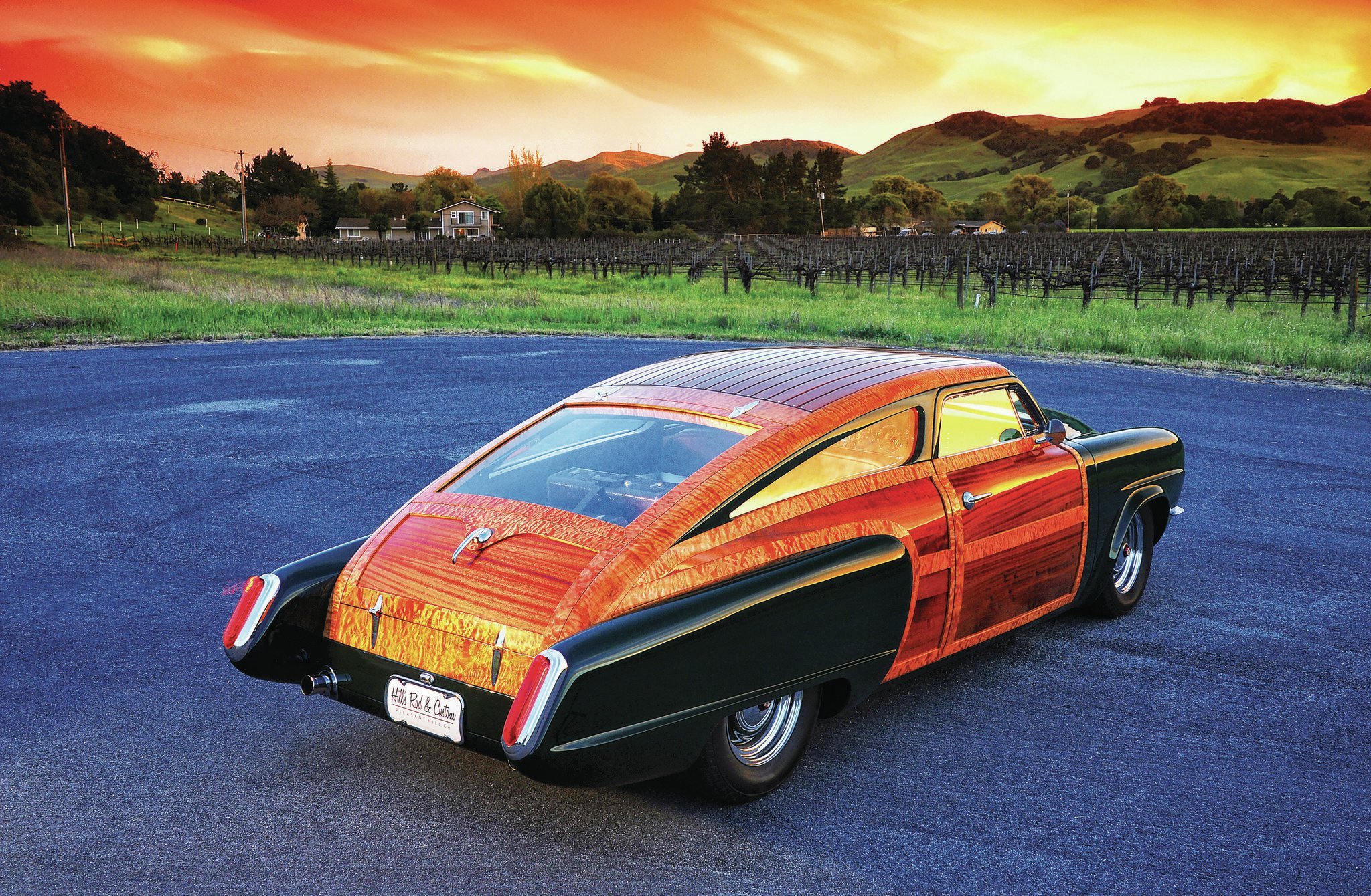 As the sun sets, the highly figured maple wood really screams. The rear fenders have been extended and incorporate custom bezels and taillights. Other custom sheetmetal includes the custom rolled pan. The wheels were custom made by Larry Westervelt.