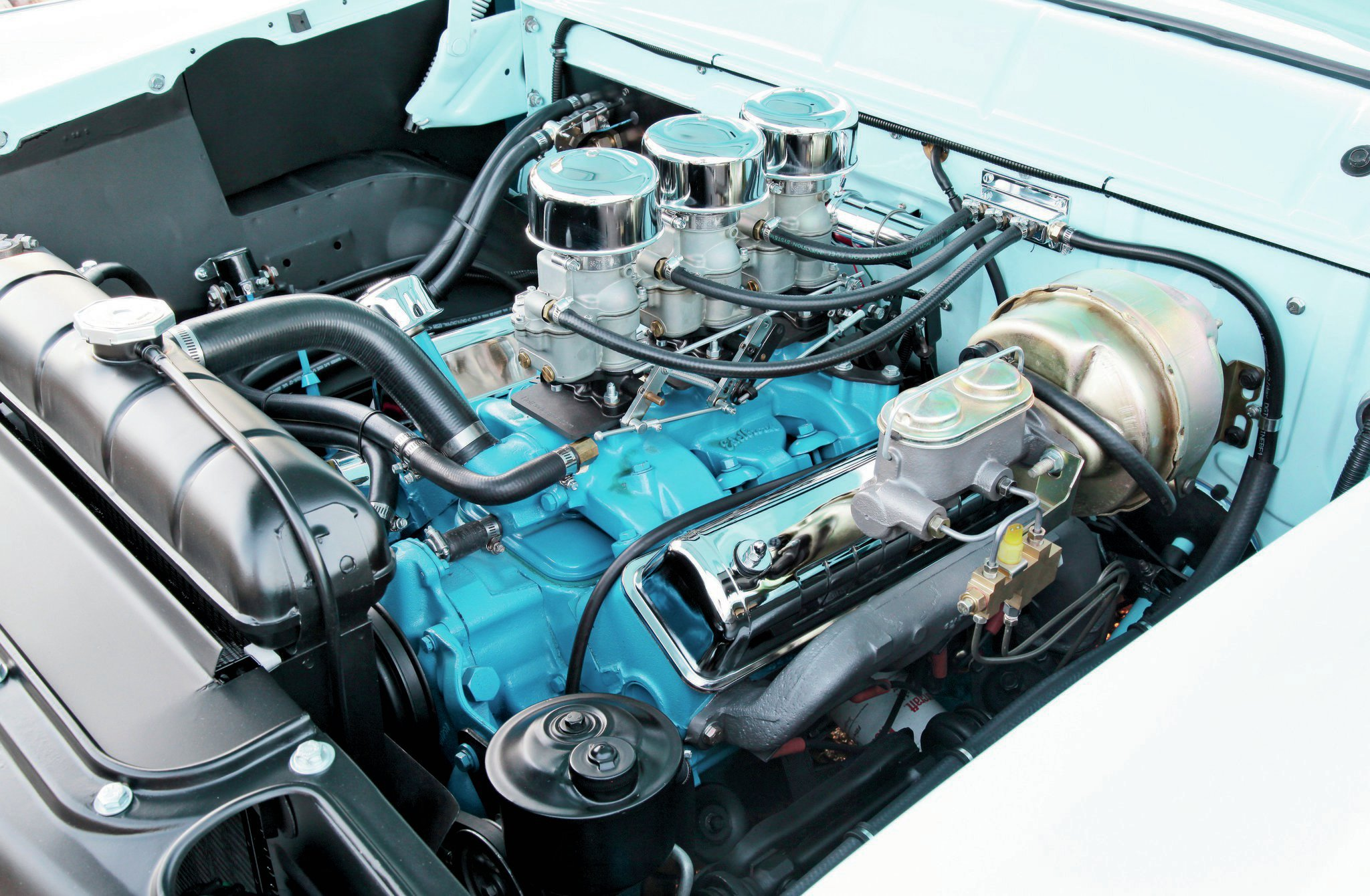 The stock 272-inch Y-block Ford had its heads freshened up and it's fed by an Edelbrock triple 94 carb setup. Smitty's mufflers provide some added performance, while a chrome air cleaner and valve covers from Speedway Motors dress up the engine.