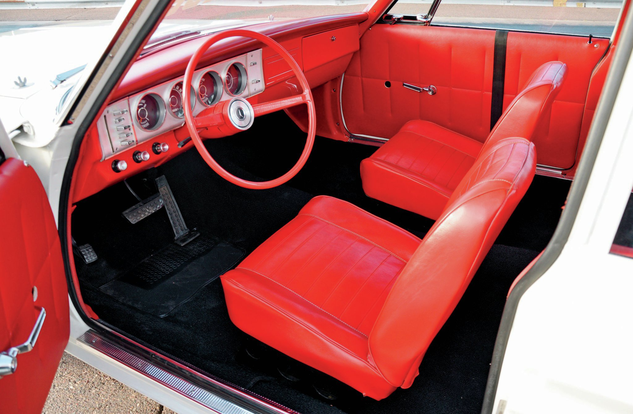 The interior features A100-style seats, no backseat, straps for the light Corning glass, and no sound deadener.