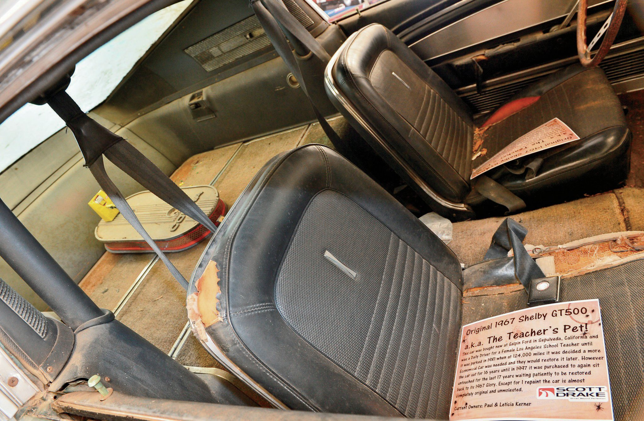 The inertial reel shoulder harnesses are still in place. Note the oval Cobra air cleaner on the fold-down rear seat shelf.
