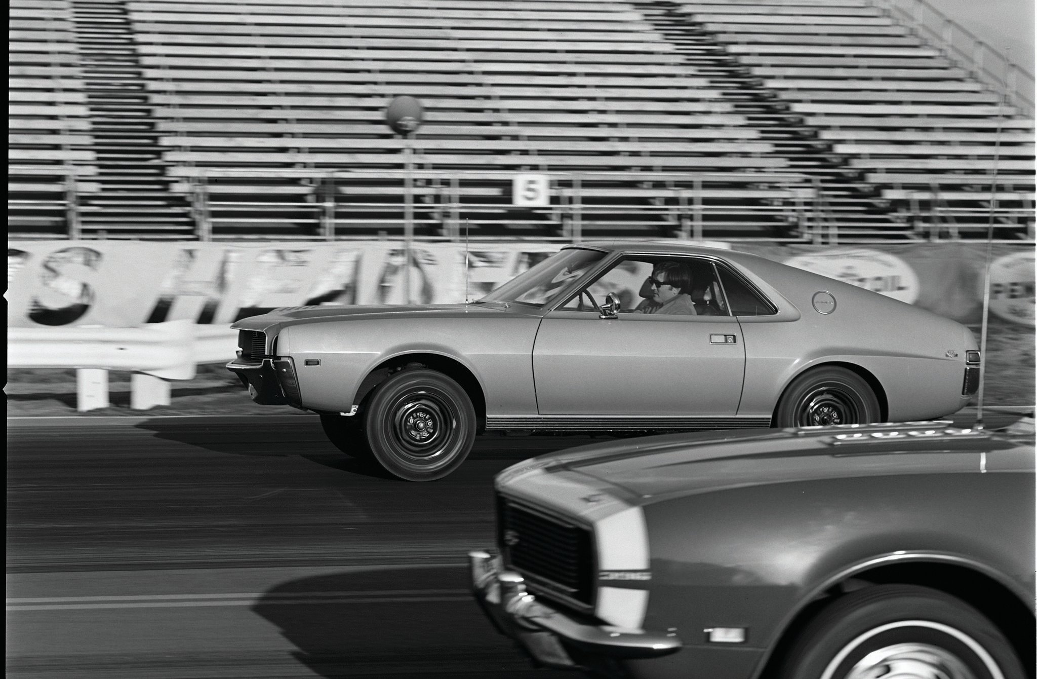 This photo was taken at OCIR by Bill Swaim of Car Craft, but we could find no corresponding story in Car Craft to find out who won. Period road tests in other magazines put the Camaro SS396 in the 15.0-15.2 range, so it would have been a close race.