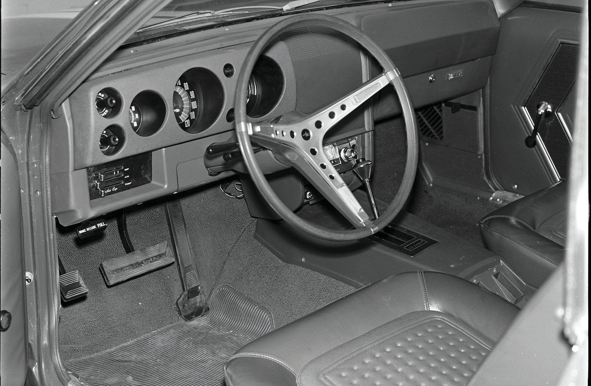 "MT's Sanders liked the ""well contoured seats,"" while SCG's Blundsen thought the cushions were too shallow. Sanders did knock the tach (to the left of the speedo) for being too small."