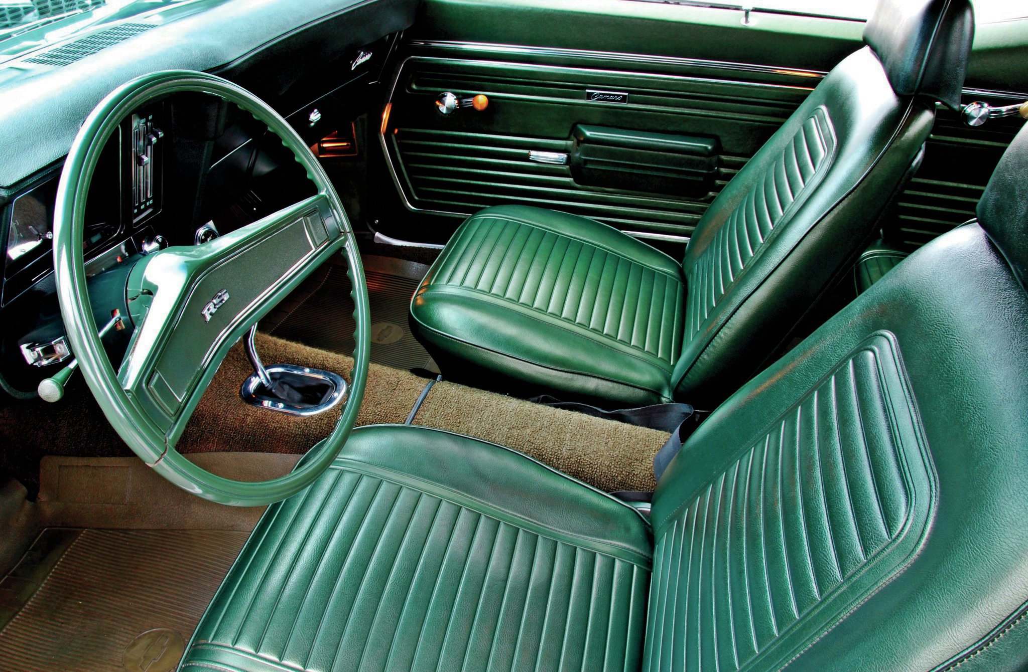 The faded carpet is about the only tipoff to the interior's original condition. The vinyl seats are in mint condition.