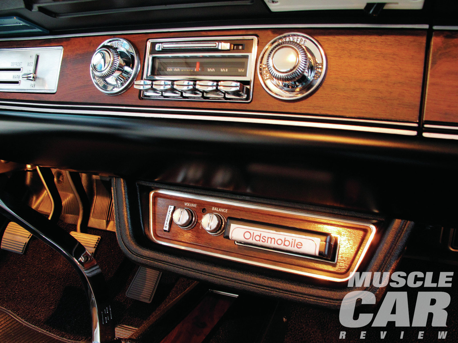 The interior of James' W-30 is showroom fresh and inviting, from the immaculate white upholstery to the tastefully understated choice of options—like the underdash tape deck.