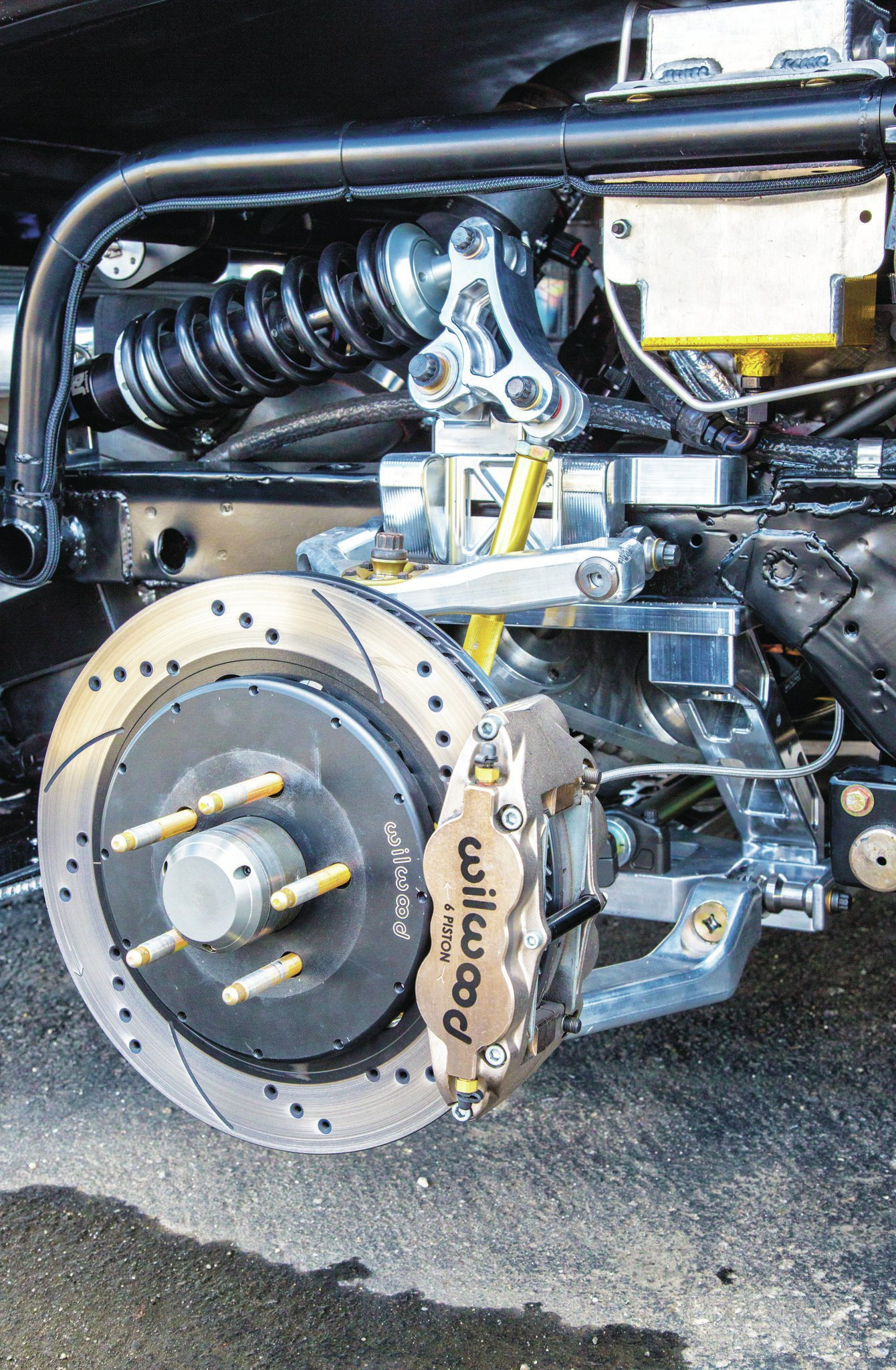 Wilwood two-piece, 14-inch rotors and six-piston calipers are used in the front while 13-inch rotors and four-piston calipers are used in the rear. Note the cantilever suspension that uses a pushrod and bellcrank to transfer loads from the suspension to the coilover.