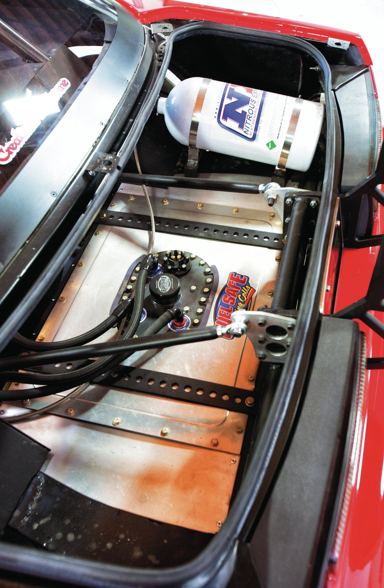 Under the decklid you'll find the Nitrous Express N-tercooler tank, Fuel Safe fuel cell, and wing mounting bracket.