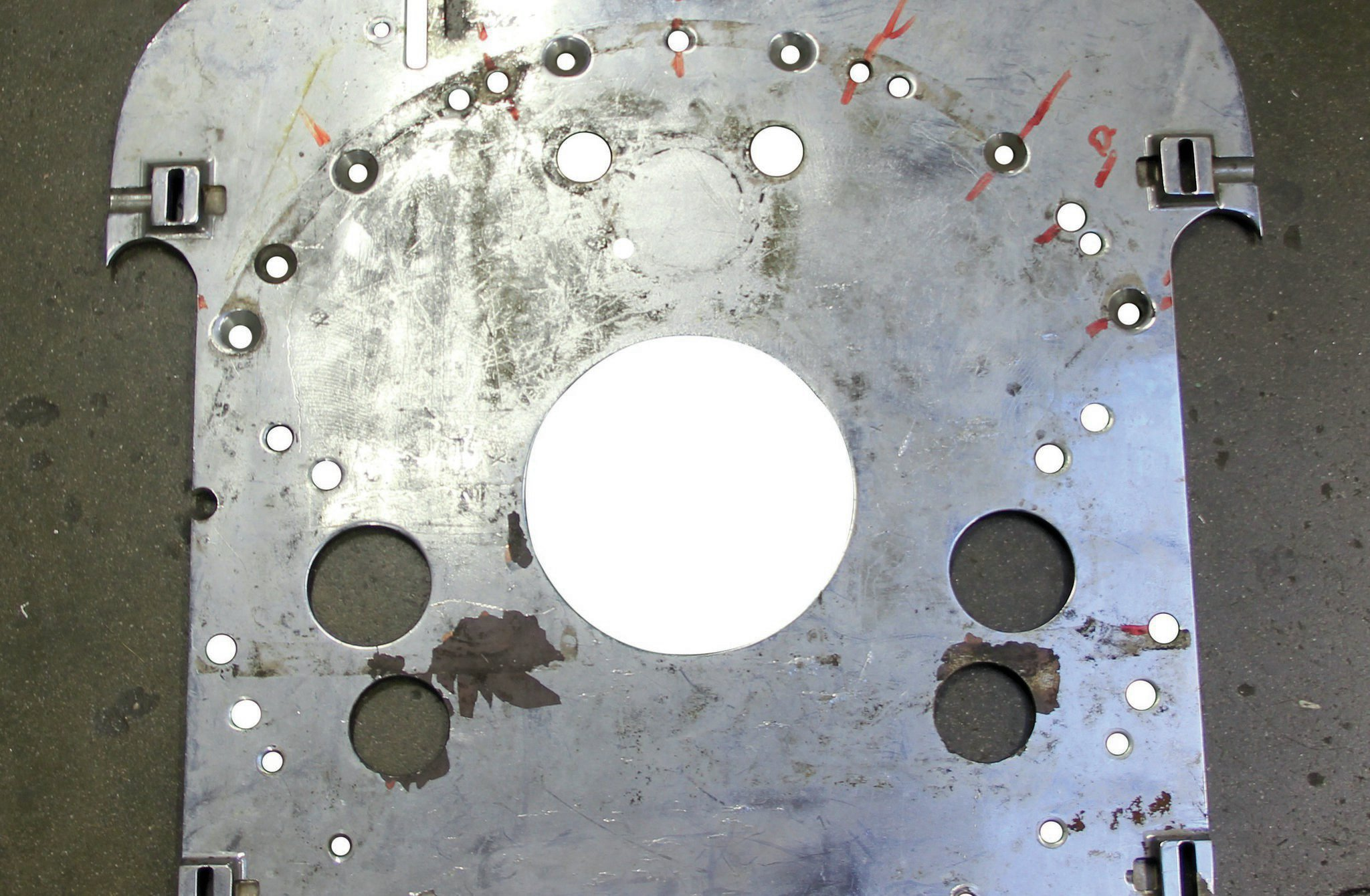 The original motor plate is all that's left of Steve Carbone's, Don Long–built front-engine dragster. The plate was originally machined to mount a 392ci Hemi, but was then reworked by another shop to handle the 426ci Hemi used during the infamous burndown of Don Garlits at the starting line in 1971.