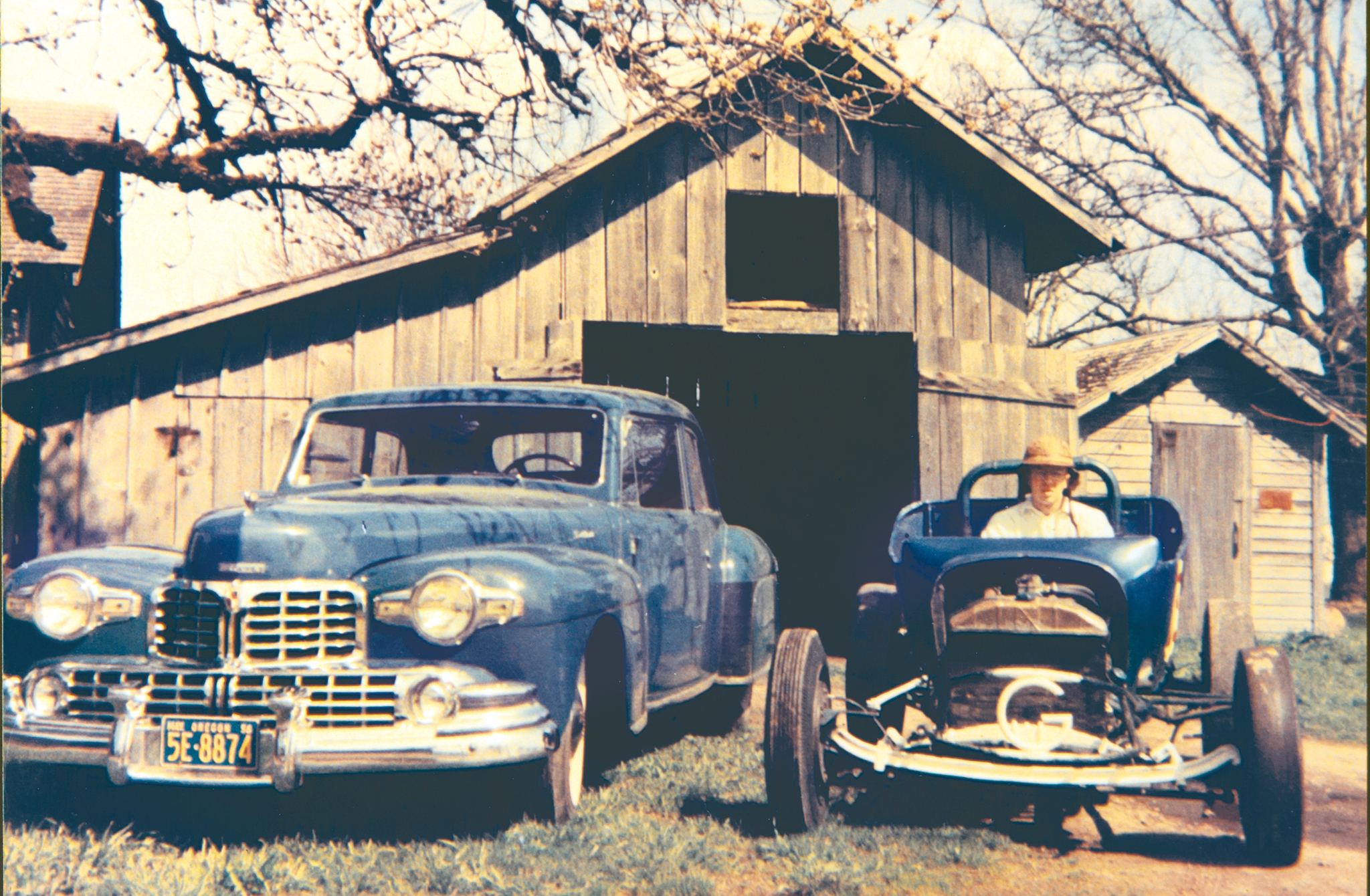 Jack's last roadster, seen here in 1955, sported a 286-inch methanol-fed flathead. The '48 Lincoln Continental parked alongside was Jack's daily driver. Jack has lived on this property since 1952. Notice the barn in the background? Jack has been known to hang onto things, and the Lincoln is parked in that barn today!