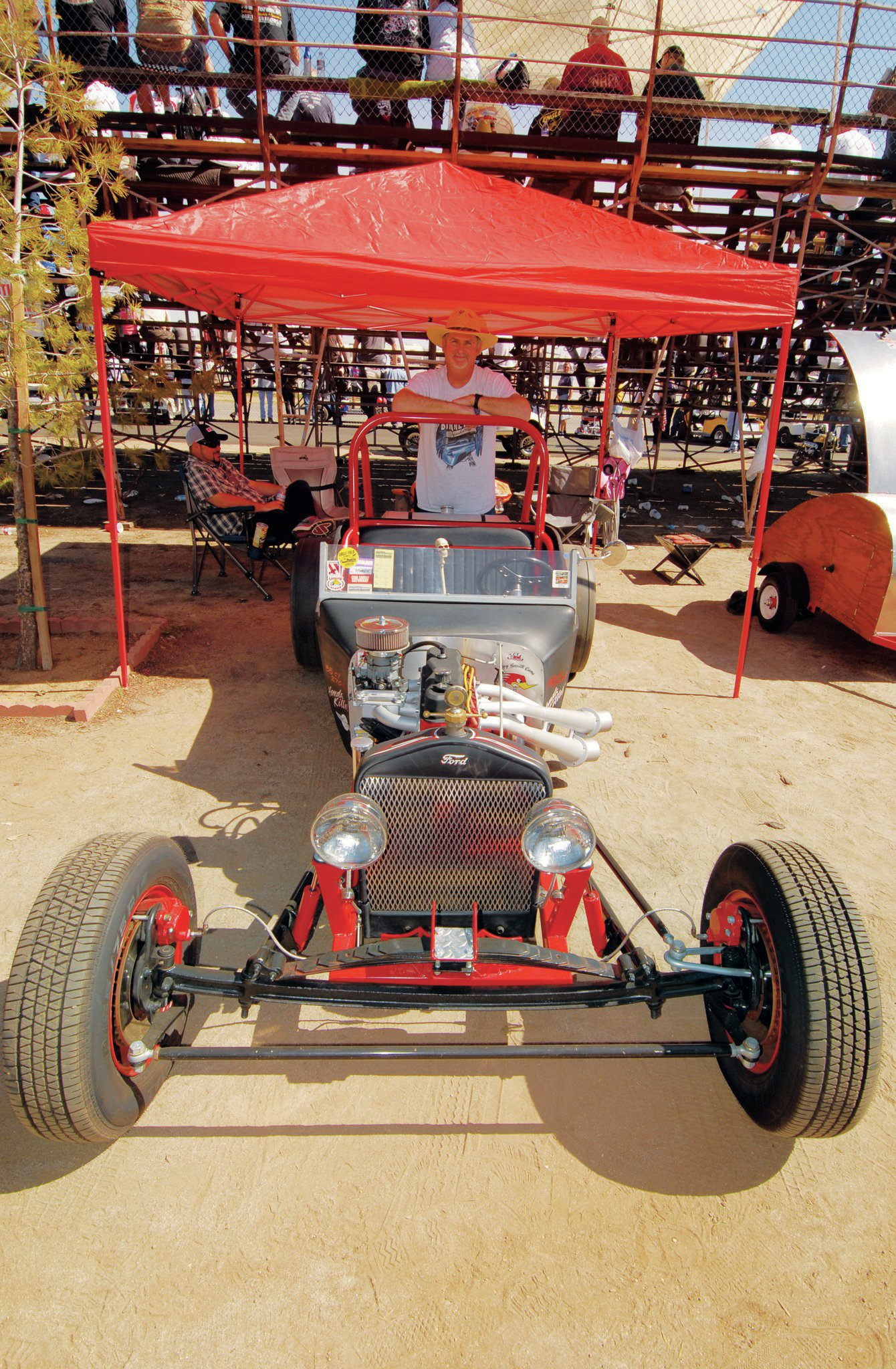 "Neil Ramey's idea of an all-American economy car combines a '23 T with the Pontiac Fiero four-banger and TorqueFlite transmission he plucked as an assembly from a retired mail wagon. His Bakersfield fab shop, Wild One Hot Rods, fabricated the chassis, suspension, front end, headers, and three rotating intake systems that range from this single Rochester 4G to a turbocharged setup. The whole package weighs just 1,280 pounds, Neil insists, and ""handles like a go-kart."""