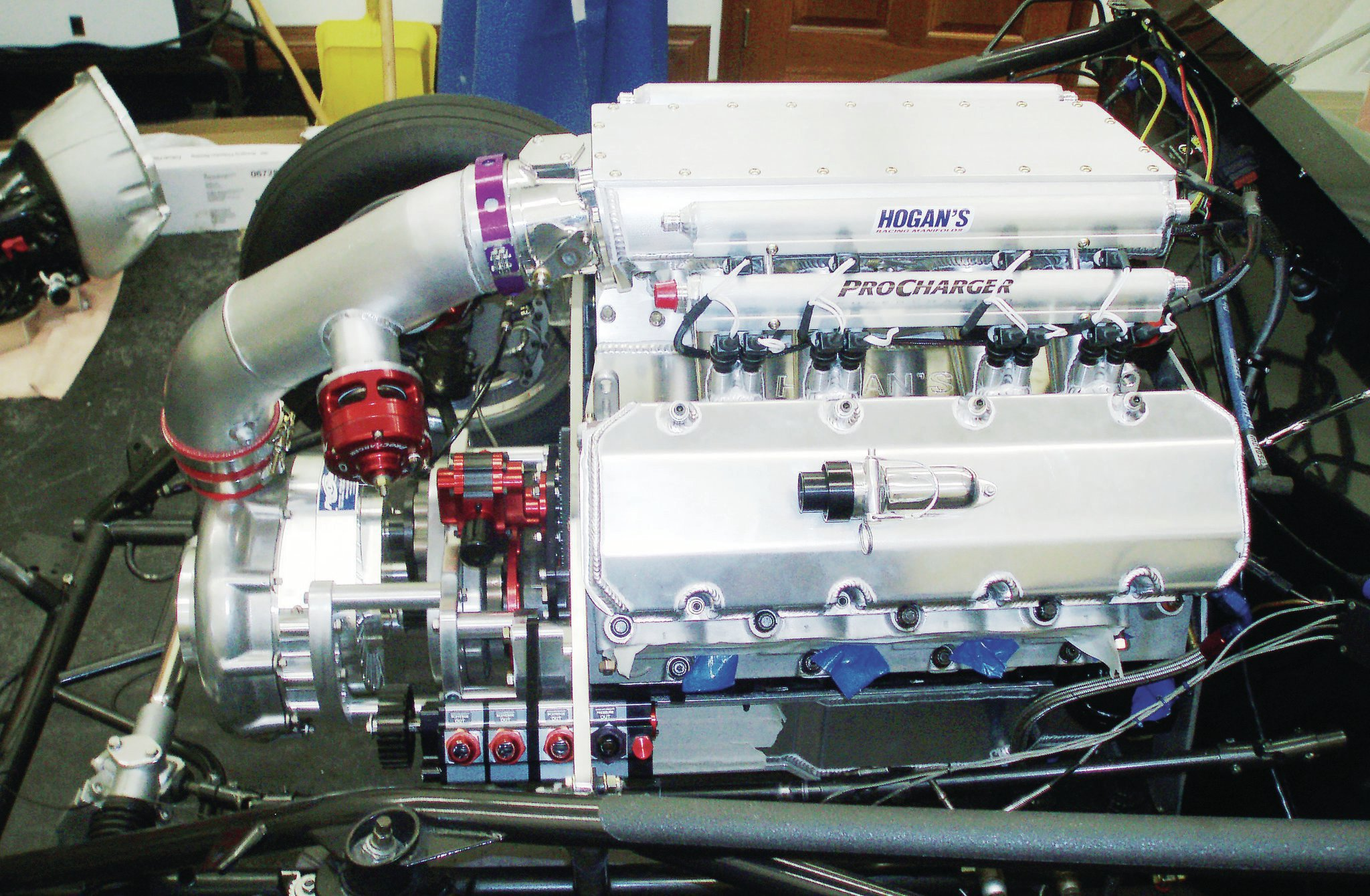 Centrifugal superchargers are basically crank-driven turbochargers. The current trend is to lose the belt and drive these huge centrifugal blowers directly off the crankshaft snout. That's a ProCharger F3R 139 on Jarod Wenrick's 565ci big-block Chevy in his NMCA Pro Street '68 Camaro. The crank drive is from The Supercharger Store (TheSuperchargerStore.com). Wenrick won the '07 NMCA Pro Street title running 6.40s at 220 mph.