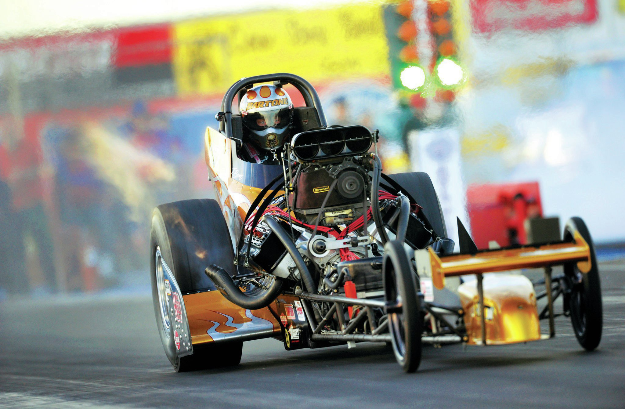 A long tow from Long Island paid off in a clean sweep of Top Fuel Eliminator, all on the same run. In the final round, Tony Bartone set overall low e.t. (5.623) and top speed (262.13), defeating Rick White (5.715, 252.52). Legendary tuner Steve Boggs produced the horsepower. National Dragster photographer Marc Gewertz got the shot.