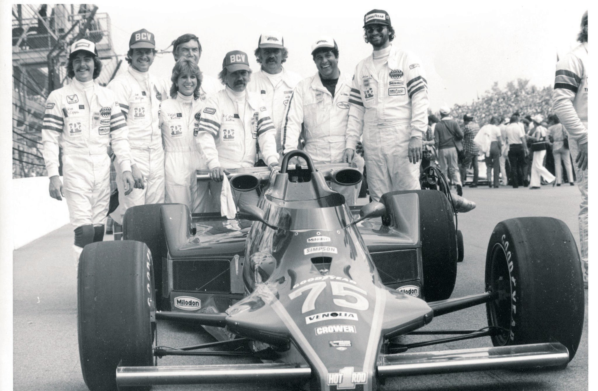 """""""Buttera brought me back to Indy three times to be on his crew. This was the first one, 1982. Dennis Firestone qualified, but we lost a flywheel on the 32nd lap. I recognize Ronnie Capps left, Leigh and John Buttera, Glen Sanders right, and myself, in between Li'l' John and Dennis Varni. I don't remember who stuck that HOT ROD sticker on the nose."""""""