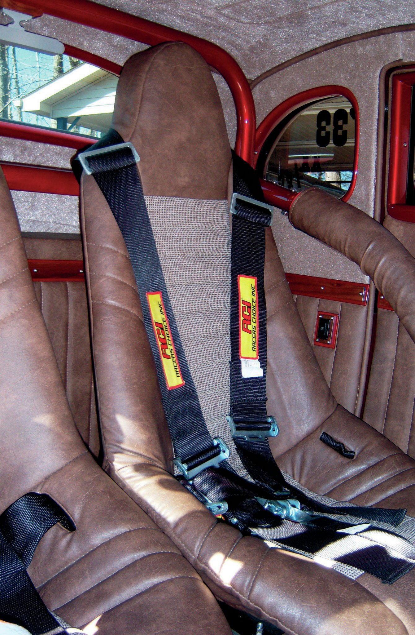 Bill and Lottie Stockwell at Bill's Auto Upholstery covered the interior, including the Jeg's fiberglass bucket seats in Carrera Tan vinyl and cloth. Notice the rollbar and safety belts are genuine competition-grade components.