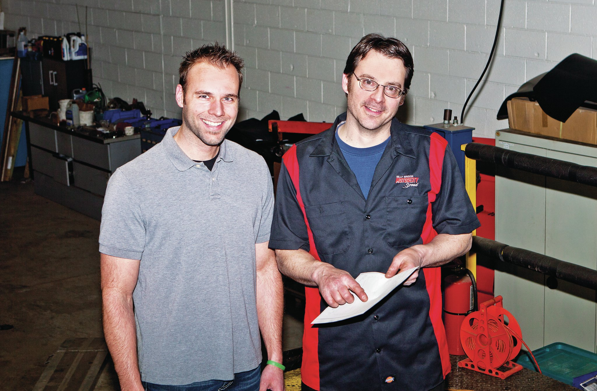 MotorCity Speed's Rich Gala (right) talks to Jason after sorting out the car's fuel supply, calibration, and valvetrain problems.